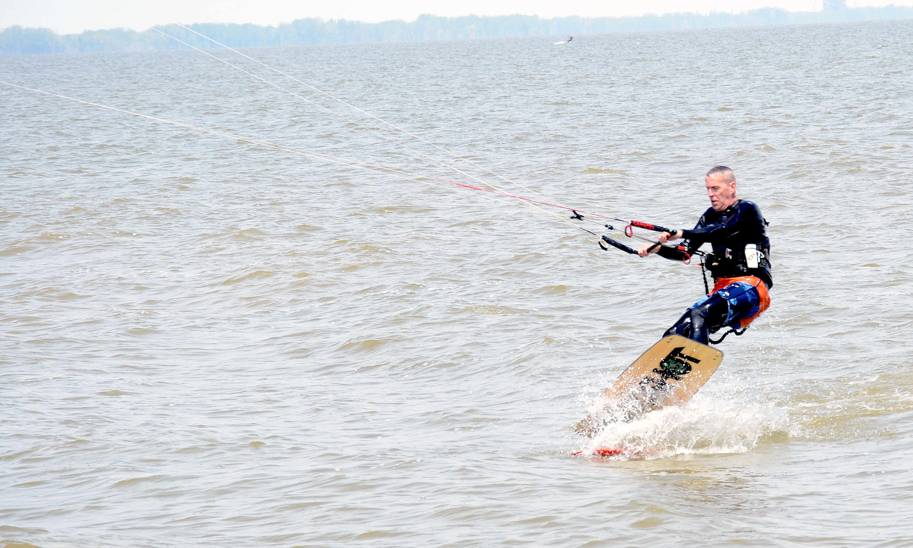 Pete Hustwayte does some kite boarding at Maumee Bay State Park. (Press photo by Ken Grosjean)