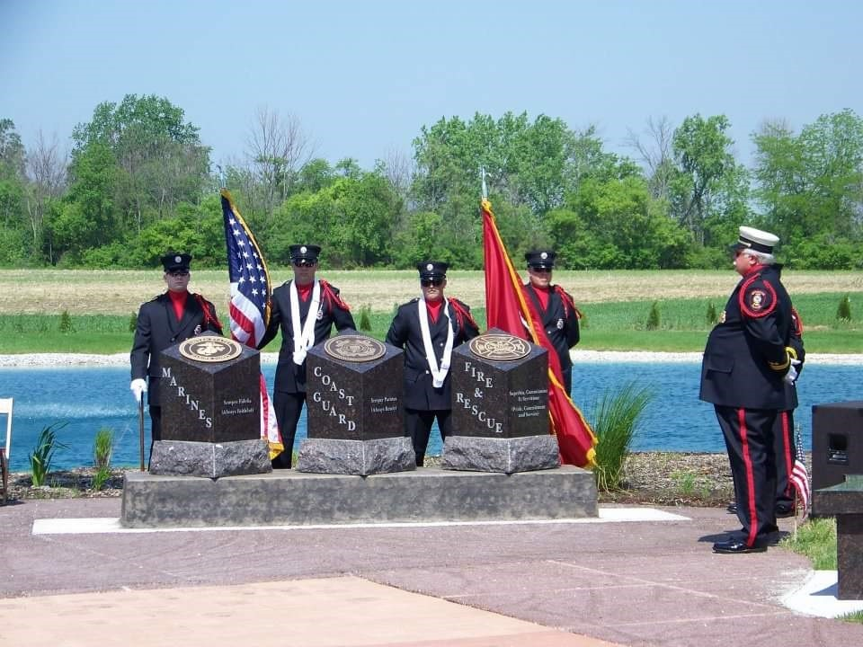Allen-Clay Joint Fire District Honor Guard members Geoff Auer, Bill Poiry, Bruce Moritz Jr., Mike Musolf, Mike Schlievert and Tim Musolf in shown at a memorial dedication ceremony at the Allen Township Cemetery in Williston. (Submitted photo)