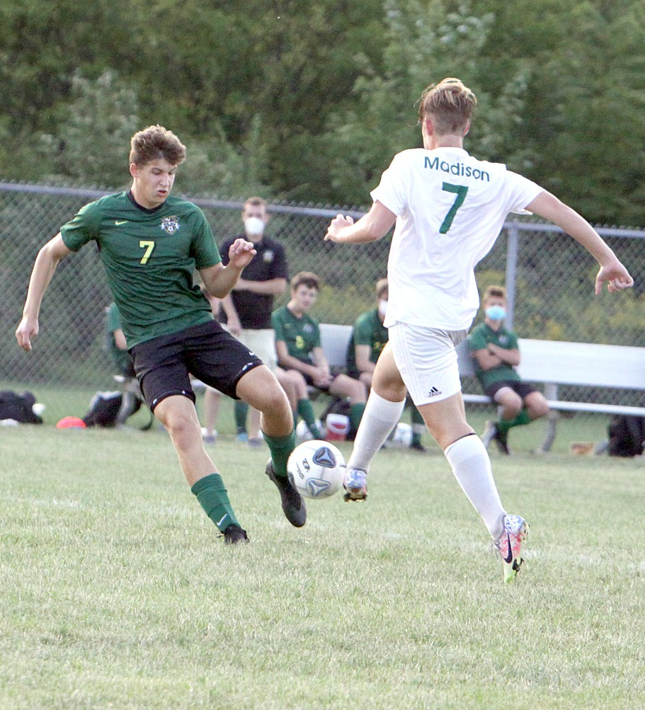 Clay junior forward Zach Wells (left) tries to get past a Mansfield Madison defender in the Eagles' 5-1 non-league home victory. (Photo by Amy Hansen)