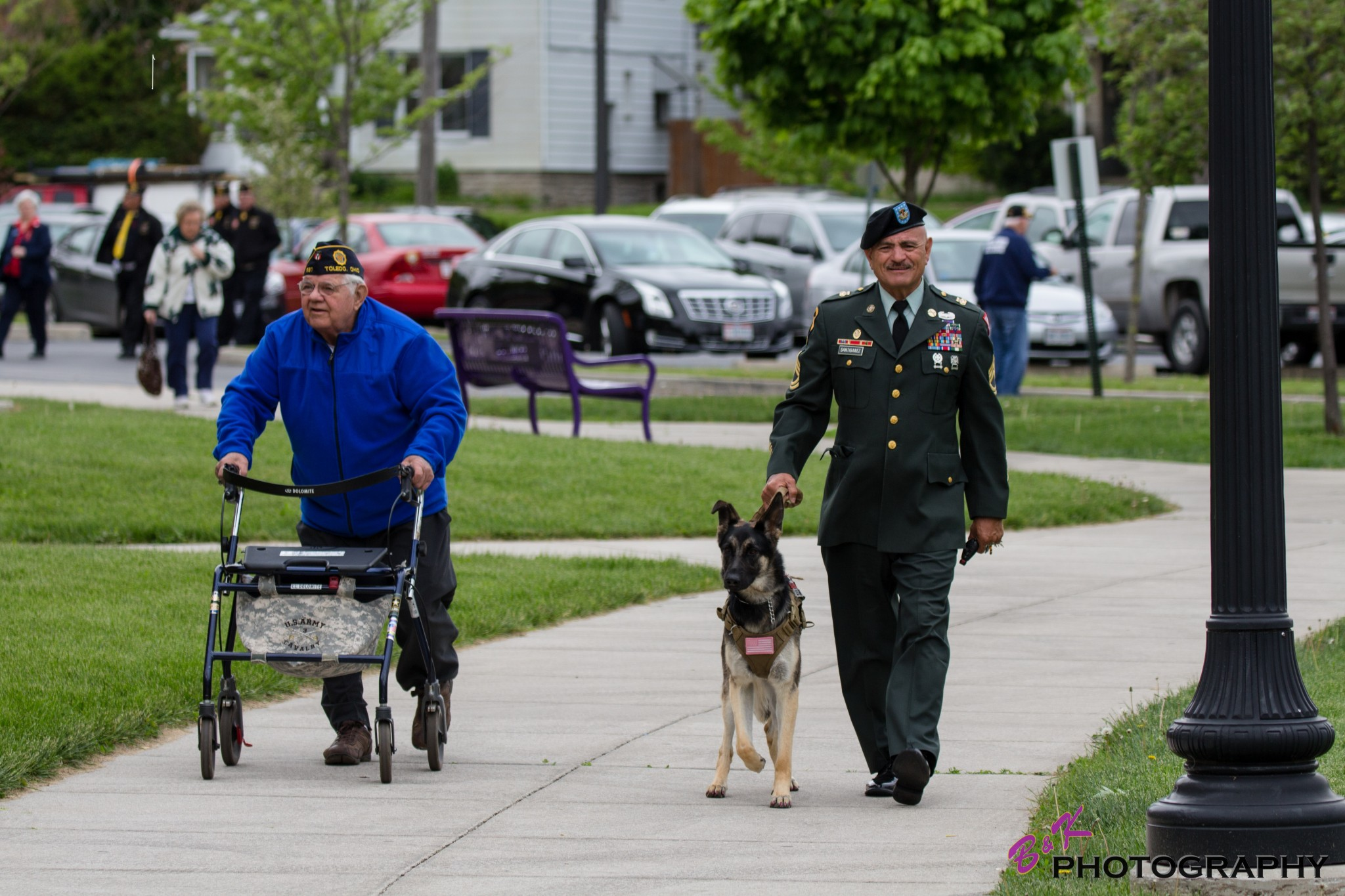 "Jack Pietras, from American Legion Post 587, (left), walks with former Waite student Army Sgt. Rudy Santibanez, and his service dog.  (Photo courtesy of B &amp; K Photo/<a href=""http://www.facebook.com/BKphotovideo"">www.facebook.com/BKphotovideo</a>)"
