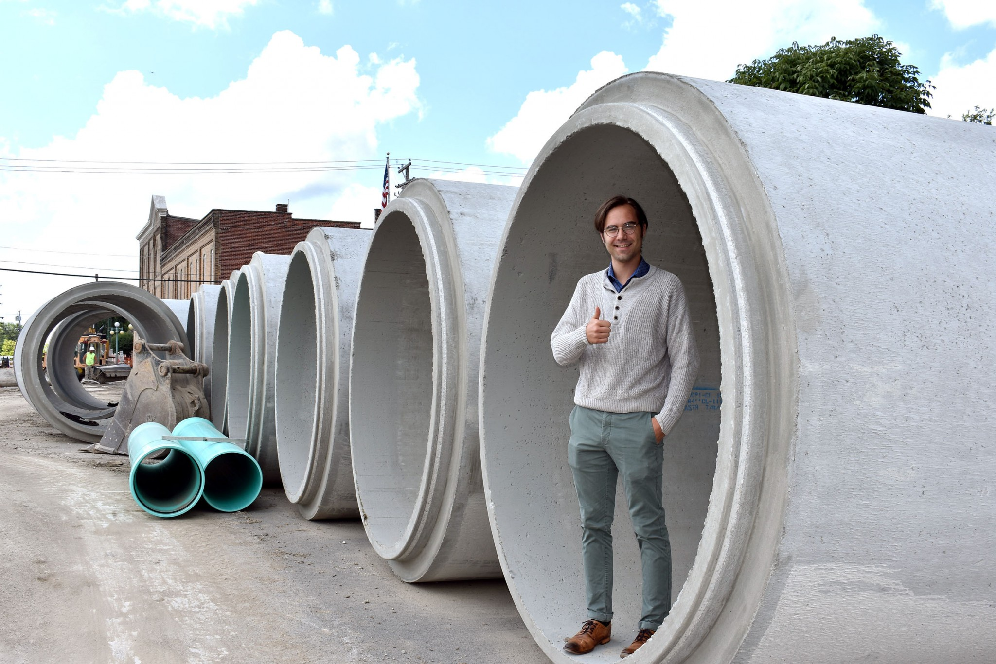 Mayor Babcock stands in an 84-inch concrete sewer pipe that will convey storm water to the Portage River. (Submitted photo)