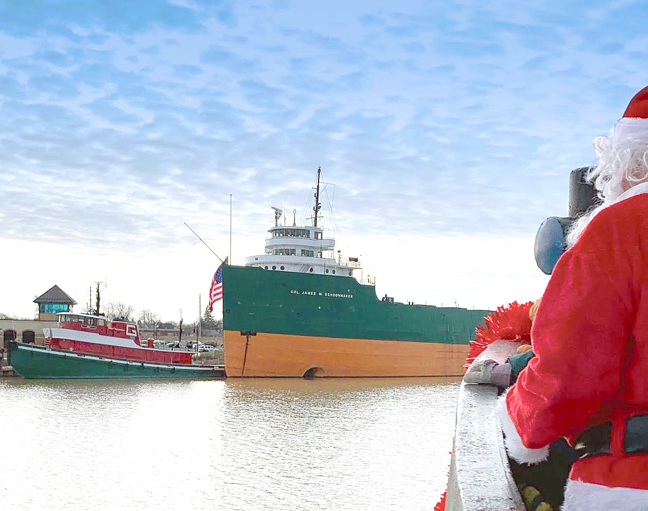 Spectators can watch live or via Facebook Live as Santa and a boatload of Christmas trees arrive at the National Museum of the Great Lakes on Saturday, Dec. 5. Those who wish to can donate a tree or contribute toward a gift card for families in need. (Submitted photo)