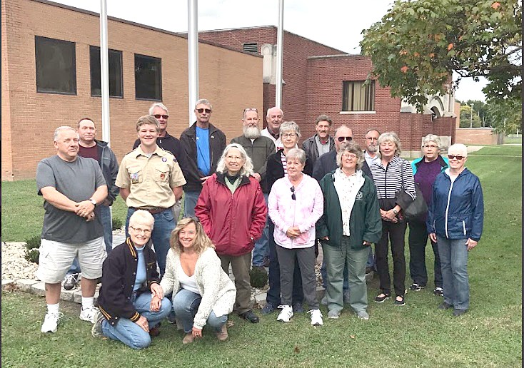 Woodmore High School junior Dylan Selhorst with members of the Woodmore Class of 1969 at the Oct. 4 dedication of new flag poles, pavers and landscaping installed around the front of the Woodmore High School building. (Submitted photo)