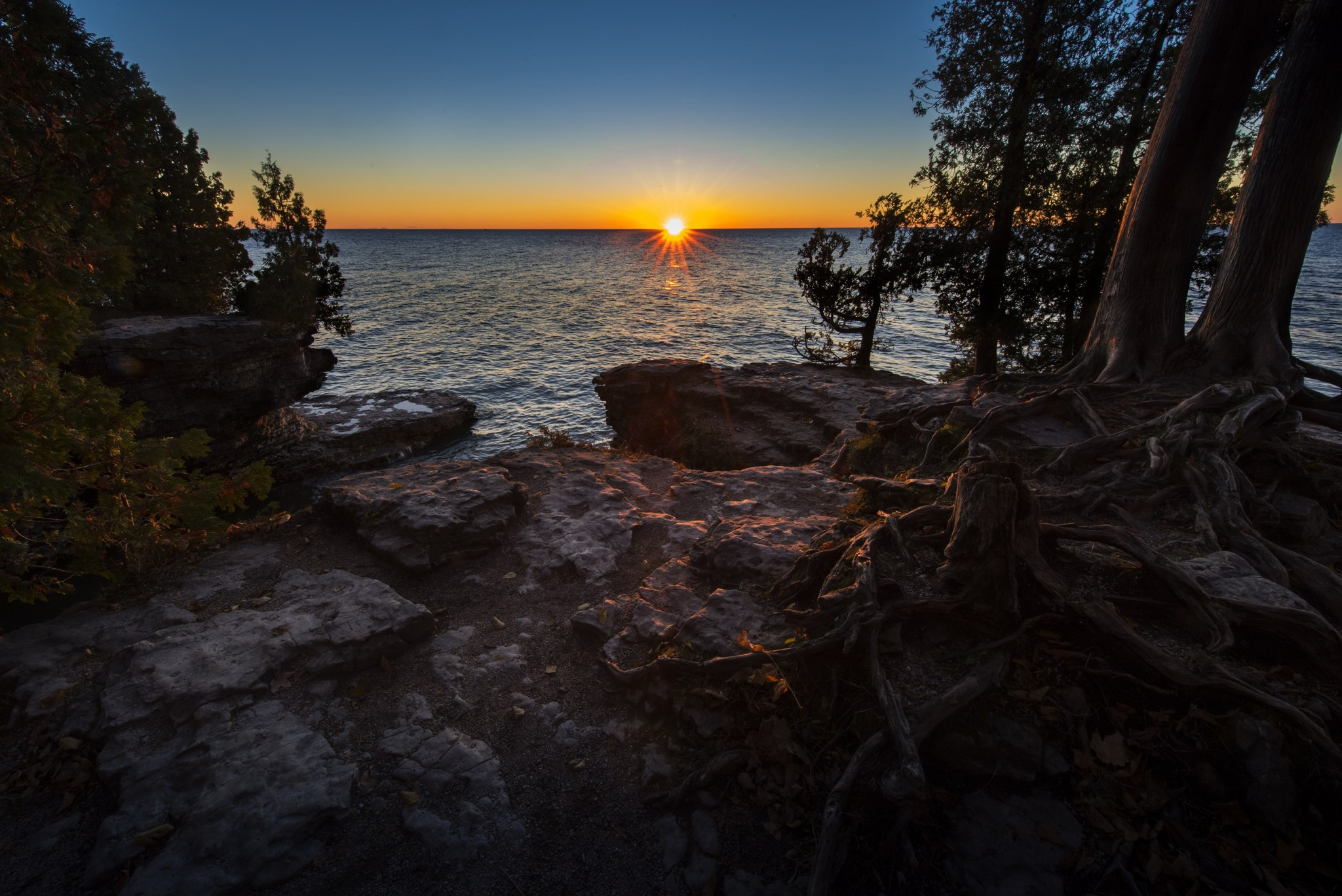 Cave Point County Park on Door County's eastern shore at sunrise. A popular area for kayaking, Cave Point protects a scenic rocky shore overlooking Lake Michigan. (Photo by Art Weber)