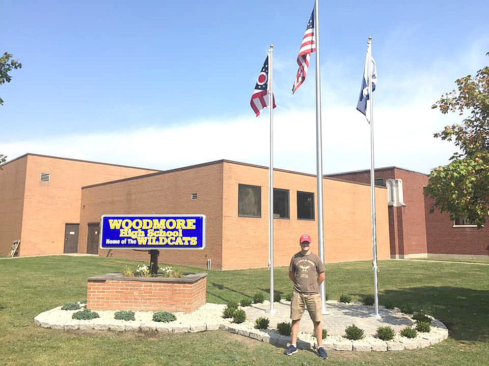Woodmore High School Junior Dylan Selhorst in front of his finished Eagle Scout Project, which included installing a patio, pavers and landscaping around flag poles in front of the school. The Woodmore Class of 1969 helped fund the project in commemoration of their 50th class reunion. (Submitted photo)