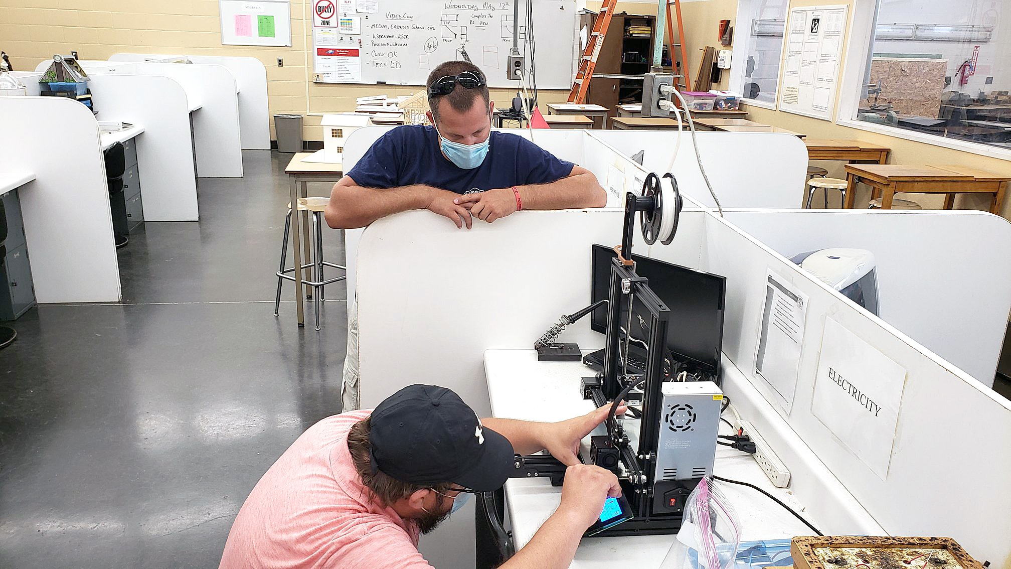 Eastwood resident Fred Hadley is seen here calibrating the heated glass print deck as Wagner looks on. (Photo courtesy of Eastwood Schools)