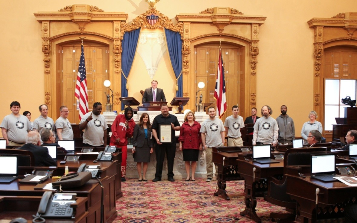 Senators Gavarone and Fedor present a Senate Resolution to members of the Lucas County Special Olympics flag football team. (Submitted photo)