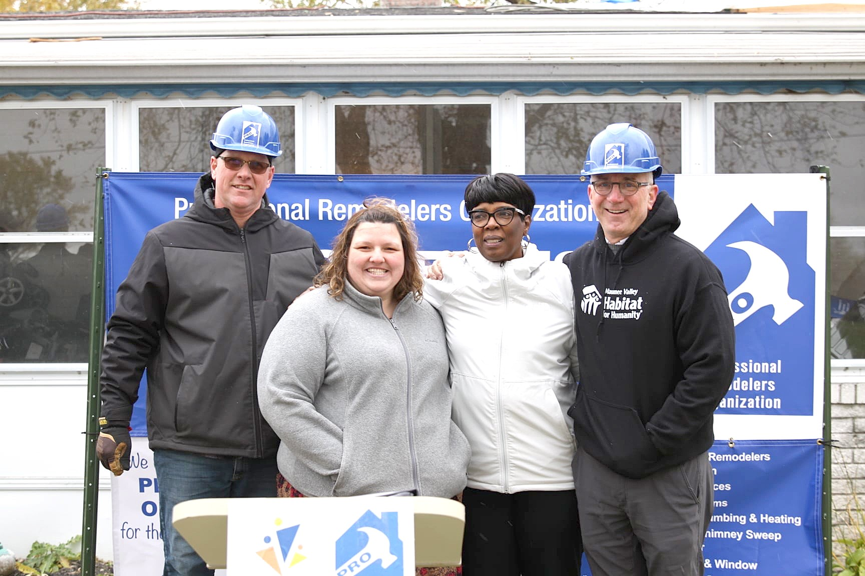 Scott Hinz, PRO president; Malori McCloskey, foster parent; Robin Reese, Lucas County Children Services director; Michael McIntyre, Maumee Valley Habitat for Humanity executive director. (Submitted photo)