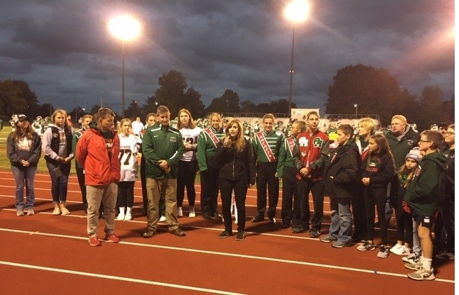State Sen. Theresa Gavarone flanked by Benton-Carroll-Salem students and staff members Oct. 4 at Rocket Stadium. (Submitted photo).