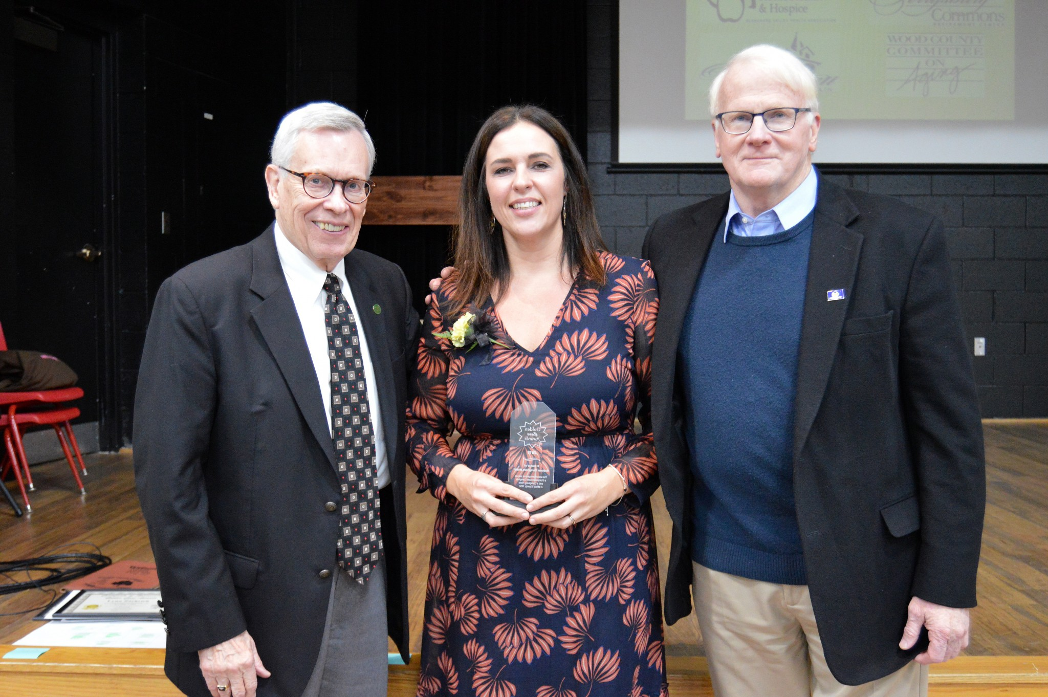 Anna Anderson, medical staff caregiver from Bridge Home Health and Hospice, pictured with Bowling Green Mayor Richard Edwards (left) and Wood County Commissioner Ted Bowlus. (Submitted photo)