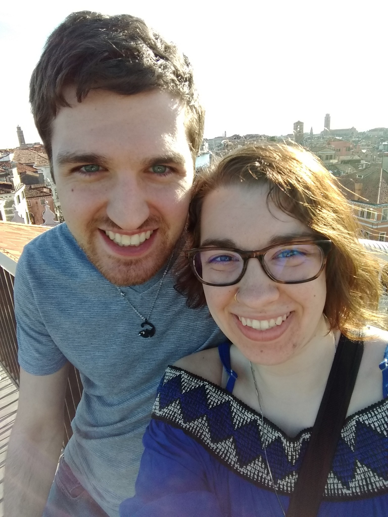 The author and her fiance, Tyler, take a break from the T Fondaco dei Tedeschi's Rooftop Terrace view to snap a quick photo. (Photo by Katie Siebenaller)