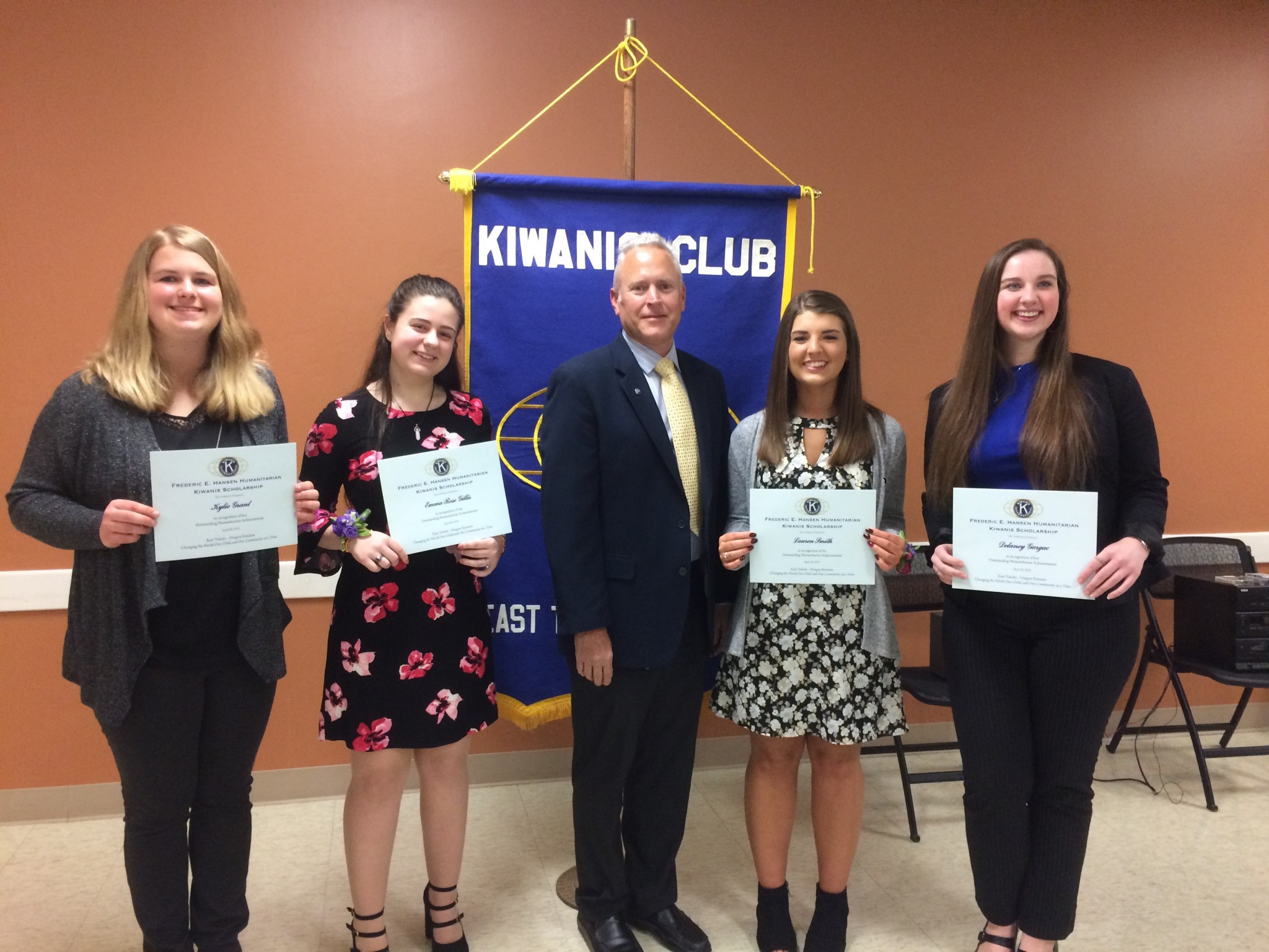 East Toledo/Oregon Kiwanis President David Gigler presented scholarship awards to high school seniors (from left) Kylie Grant, Emma Rose Gillis, Lauren Smith and Delaney Gargac at the 68th Anniversary Charter Dinner. (Submitted photo)