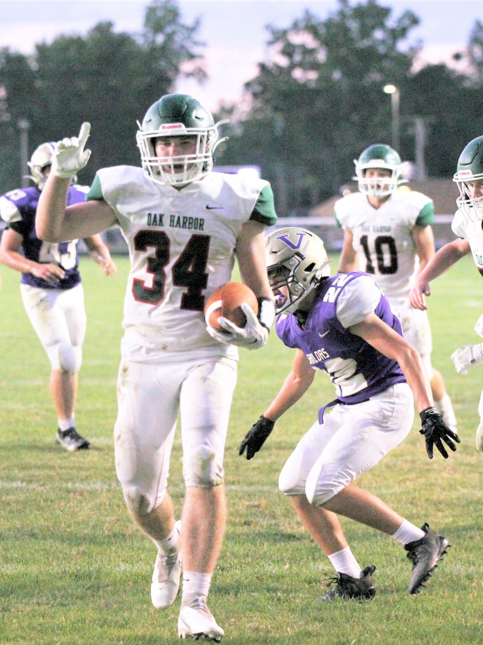 Oak Harbor senior running back Collin Fauver scores in the Rockets' 30-0 win over Sandusky Bay Conference foe Vermilion. (Photo by Laura Bolander)