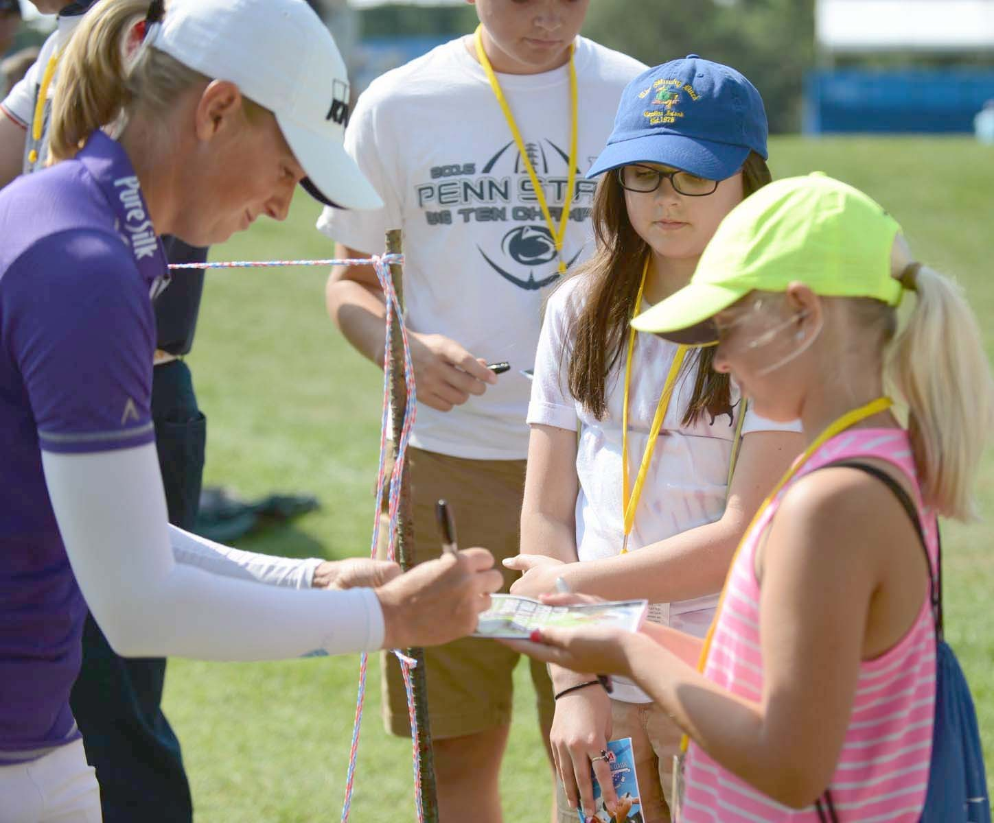 Toledo native and professional golfer Stacy Lewis signs an autograph while in town for the Marathon Classic in 2017. (Photo courtesy Marathon Classic)