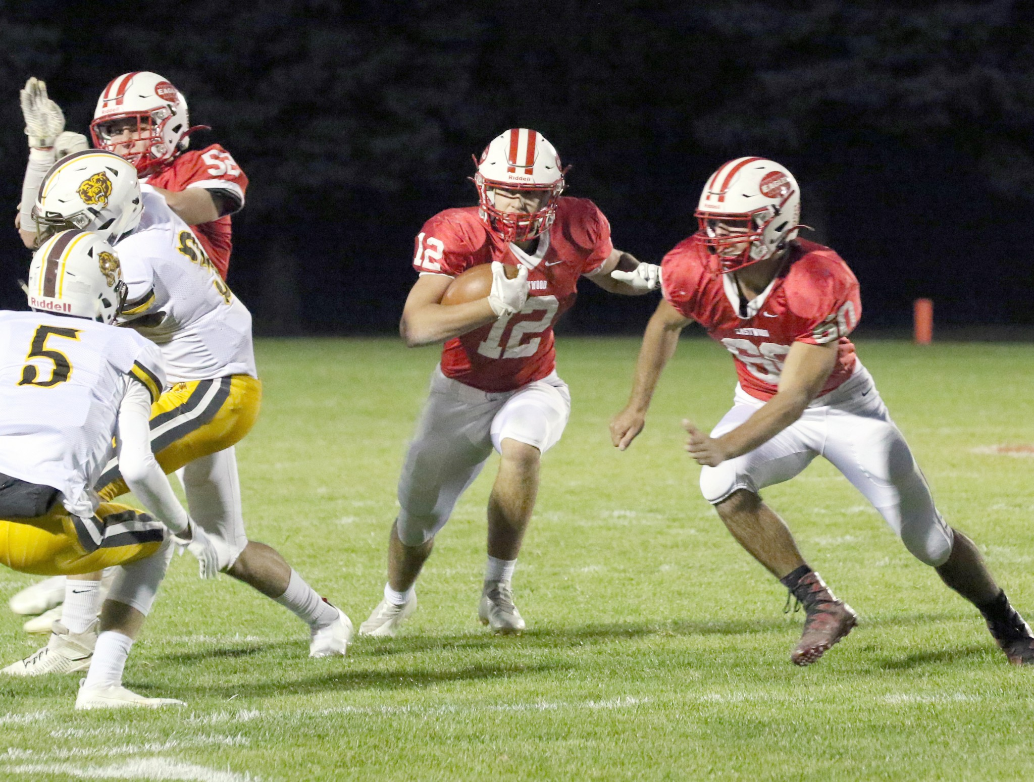 """Eastwood 6-foot-2, 197-pound senior offensive lineman Blake Landis, voted last year&#039;s Alan Miller Jewelers All-Press Lineman of the Year, looks to chase down an Apple Creek Waynedale defender so 6-2, 218-pound junior back Emmet Getz can find running room. (Press photo by Lee Welch/<a href=""""http://www.FamilyPhotoGroup.com"""">www.FamilyPhotoGroup.com</a>)"""