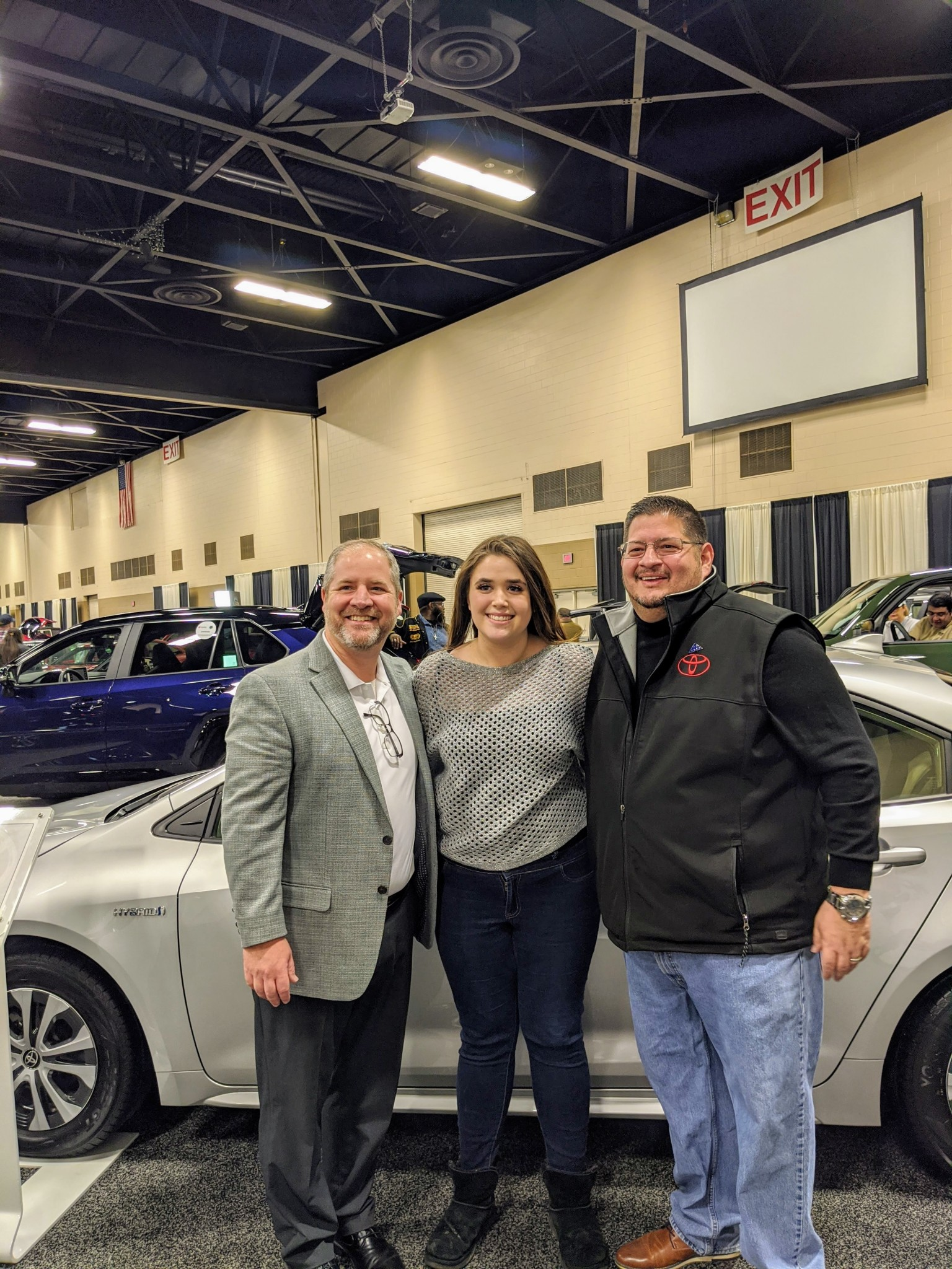Left to right, Mike Dunphy of Thayer Toyota; Marissa Martinez, winner of the Toledo Auto Show giveaway of a Toyota Corolla LE two-year lease and Vinnie Schiavone, of Jim White Toyota. (Submitted photo)