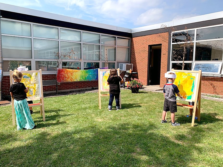 Lake students, under the instruction of art teacher Laura Lohmann, get some fresh air as they create masterpieces in their outdoor studio, set up in a school courtyard. (Submitted photo)