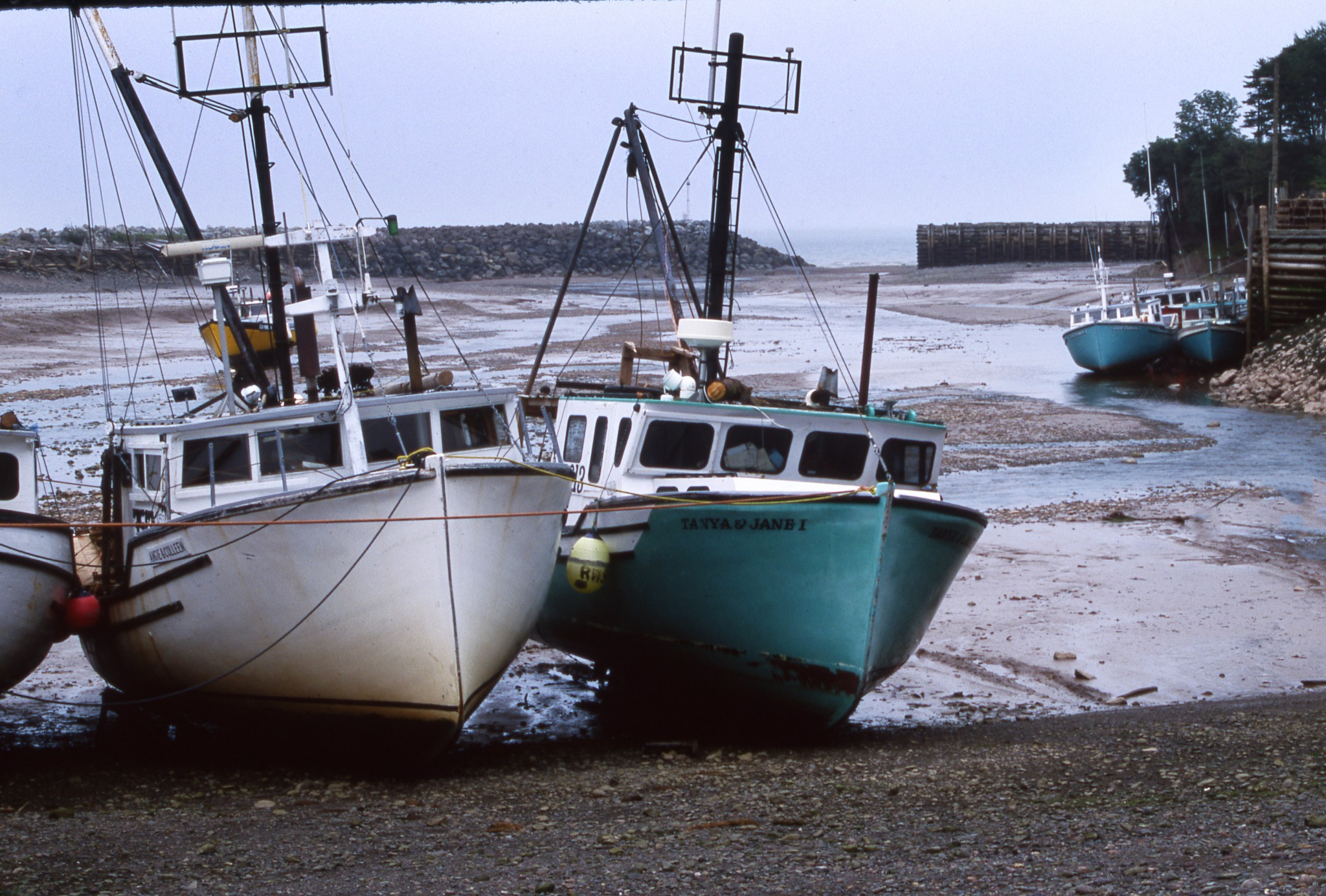 St. Martins is a picturesque New Brunswick fishing village on the Bay of Fundy that faces two low tides daily that leave their boats sitting on the bottom of their small harbor. (Photo by Art Weber)