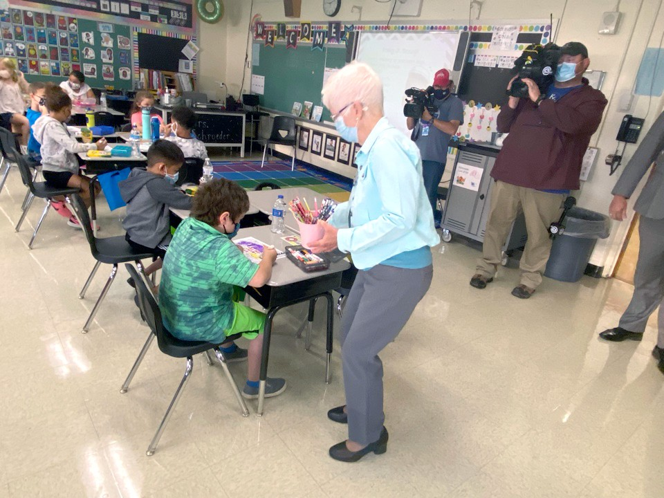 Sister Dorothy Thum, vice president, Mission and Values Integration, distributes school supplies at Starr Elementary School in Oregon on Sept. 2. (Submitted photo)