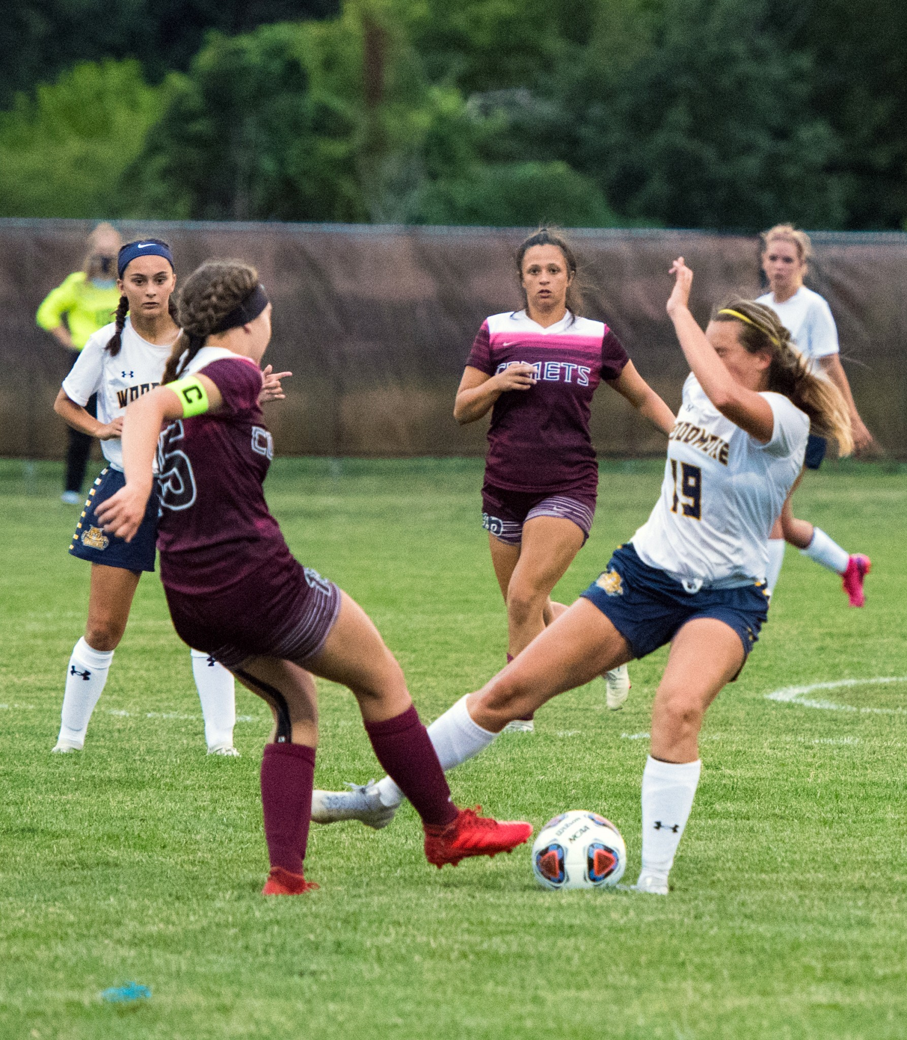 """Woodmore senior midfielder/forward Autumn Beaudoin (19) clashes with a Genoa defender. (Press photo by Russ Lytle/<a href=""""http://www.Facebook.com/RussLytle/RHP"""">www.Facebook.com/RussLytle/RHP</a>)"""