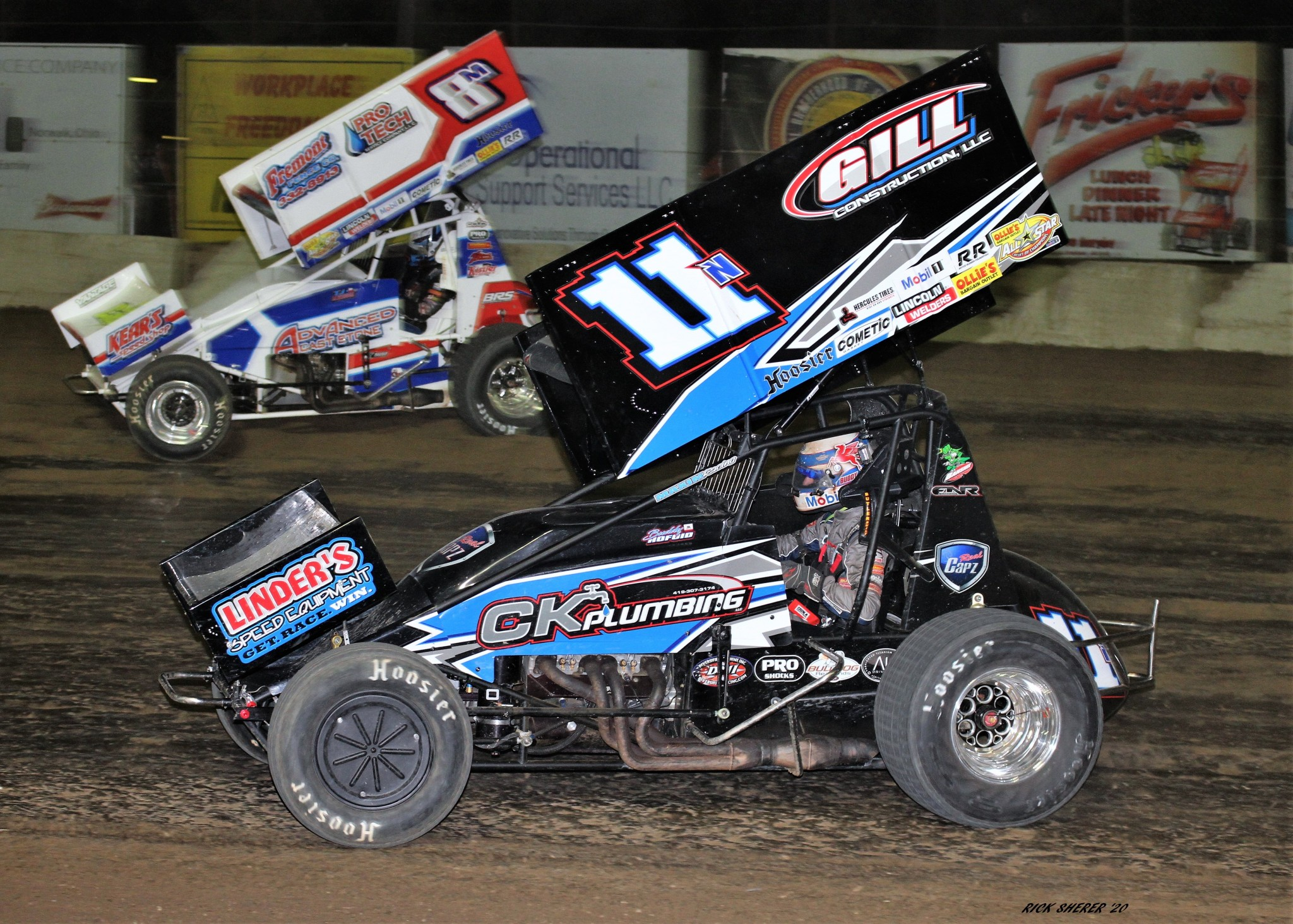 California transplant Buddy Kofoid (11n) puts T.J. Michael (8m) a lap down and runs away into the sunset to win night two of Ohio Sprint Speedweek at Fremont Speedway.