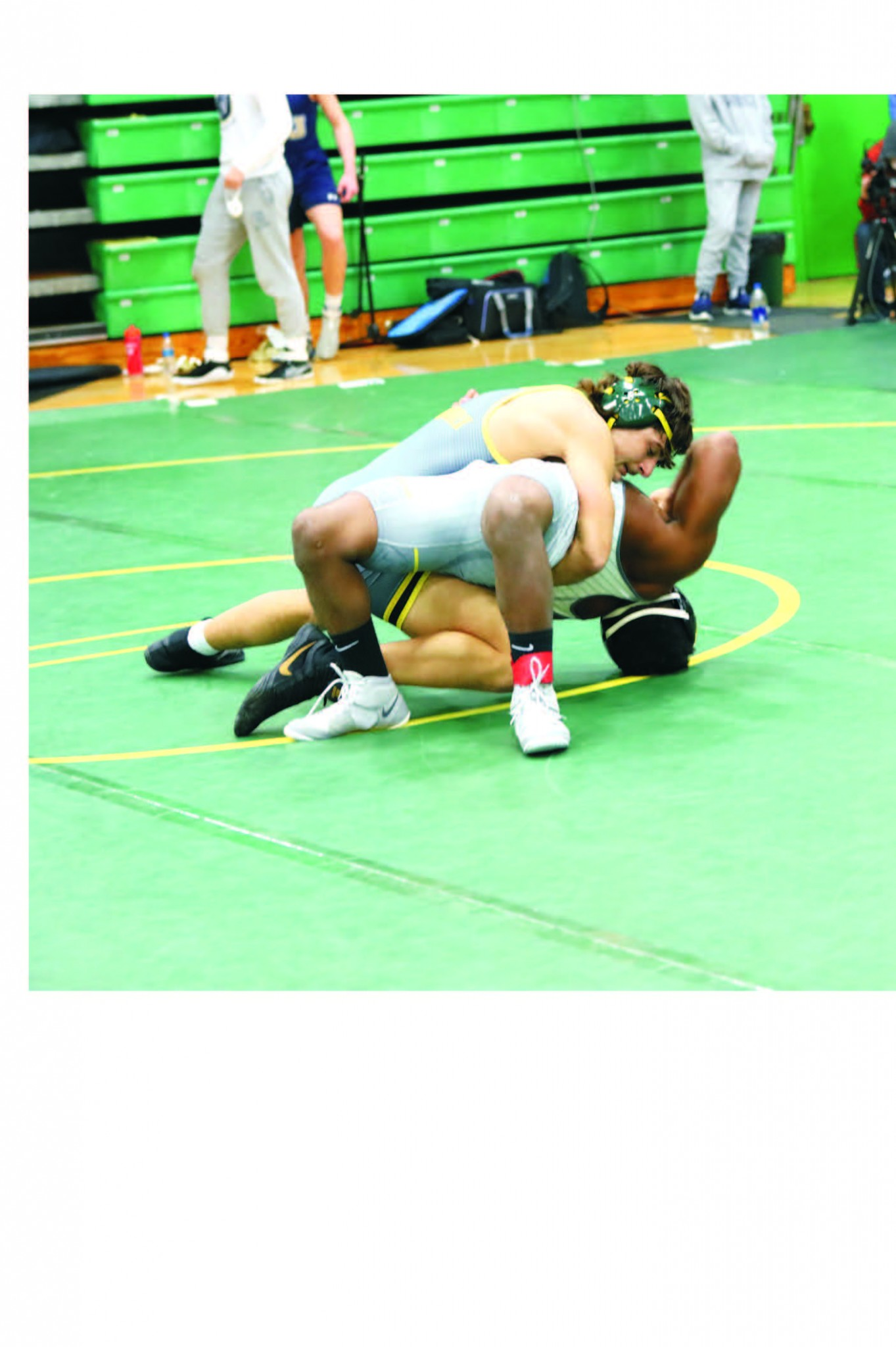 Clay junior wrestler Dominico Migliori gets a takedown. (Photo by Rich Wagner)