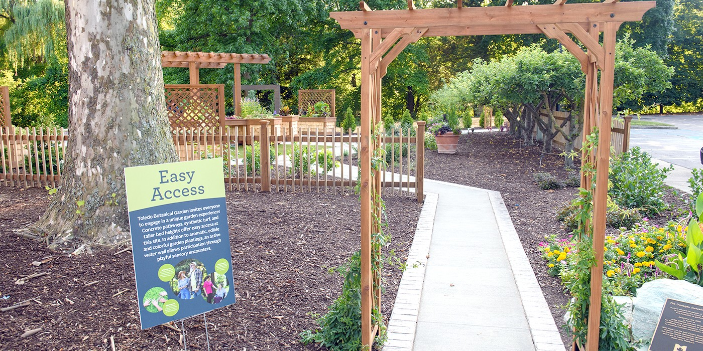 The Doneghy Inclusive Garden at Toledo Botanical Garden offers wheelchair-accessible garden beds, ADA-compliant seating within a pergola, a sensory water wall, and plantings with olfactory and touch sensory components. The garden's opening coincides with The Ability Center's 100th anniversary. (Metroparks Toledo photo)