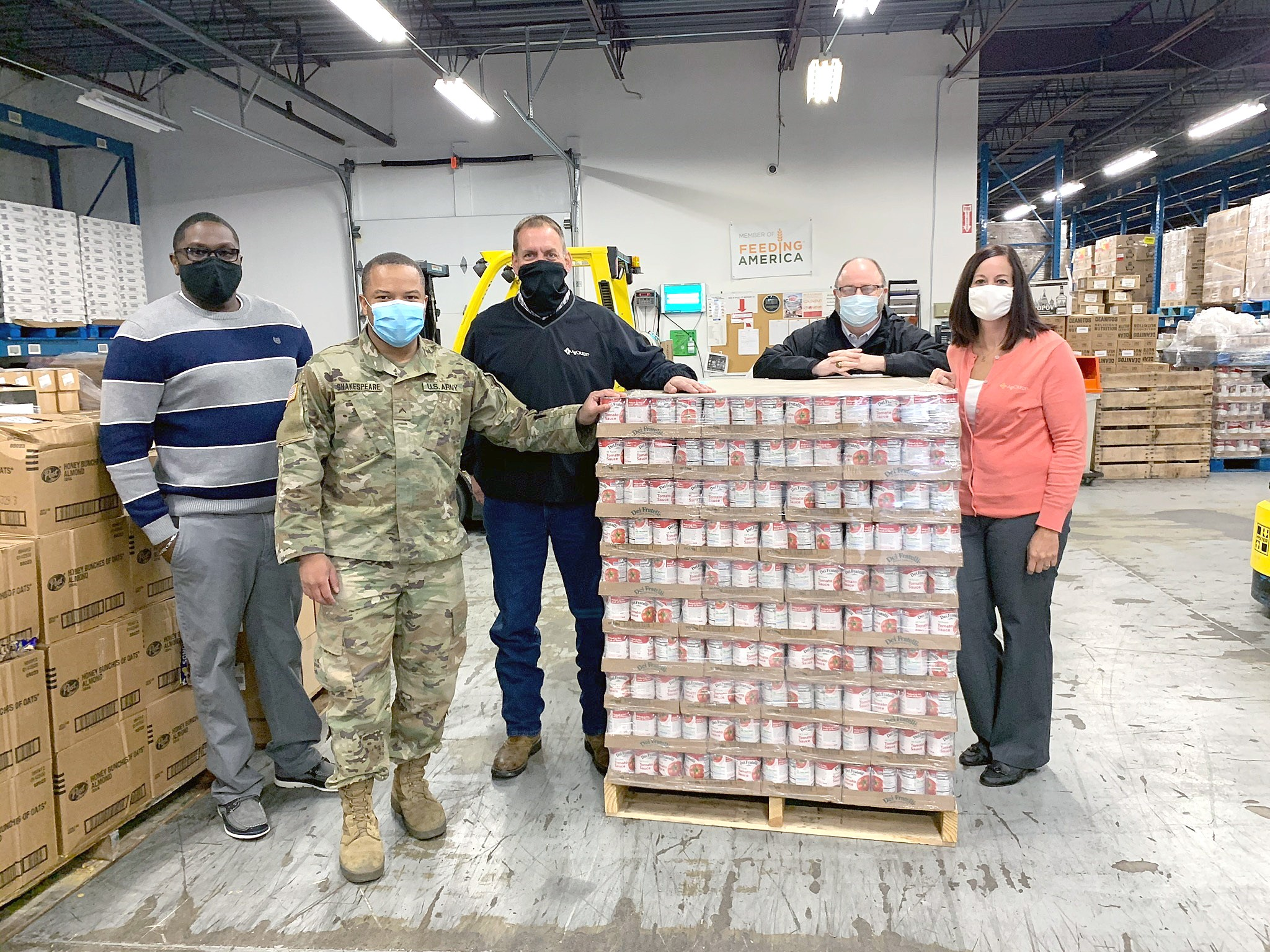 "AgCredit recently donated more than 6,100 cans of tomato sauce to the West Ohio Food Bank, Toledo Northwestern Ohio Food Bank and Second Harvest Food Bank of North Central Ohio as part of the lender's ""Sharing the Harvest by Giving Thanks"" campaign. (Submitted photo)"