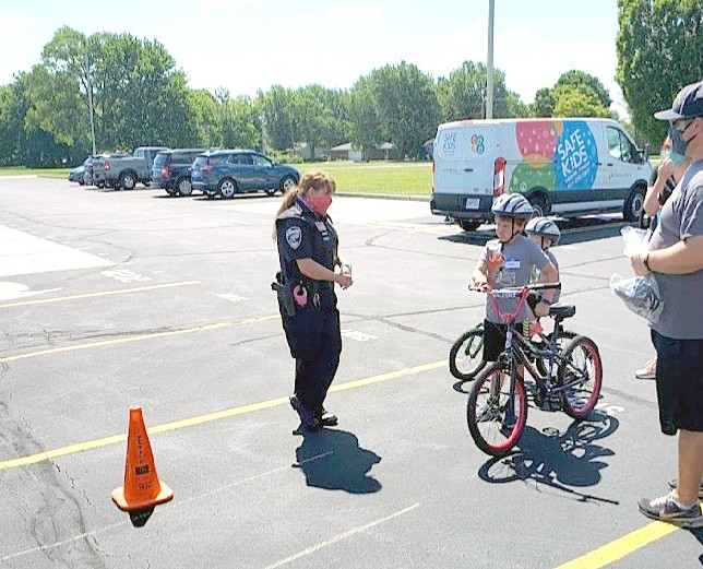 Woodmore High School Resource Officer Laura Condon discusses bicycle safety at a Bicycle Safety Rodeo held July 11. (Submitted photo)