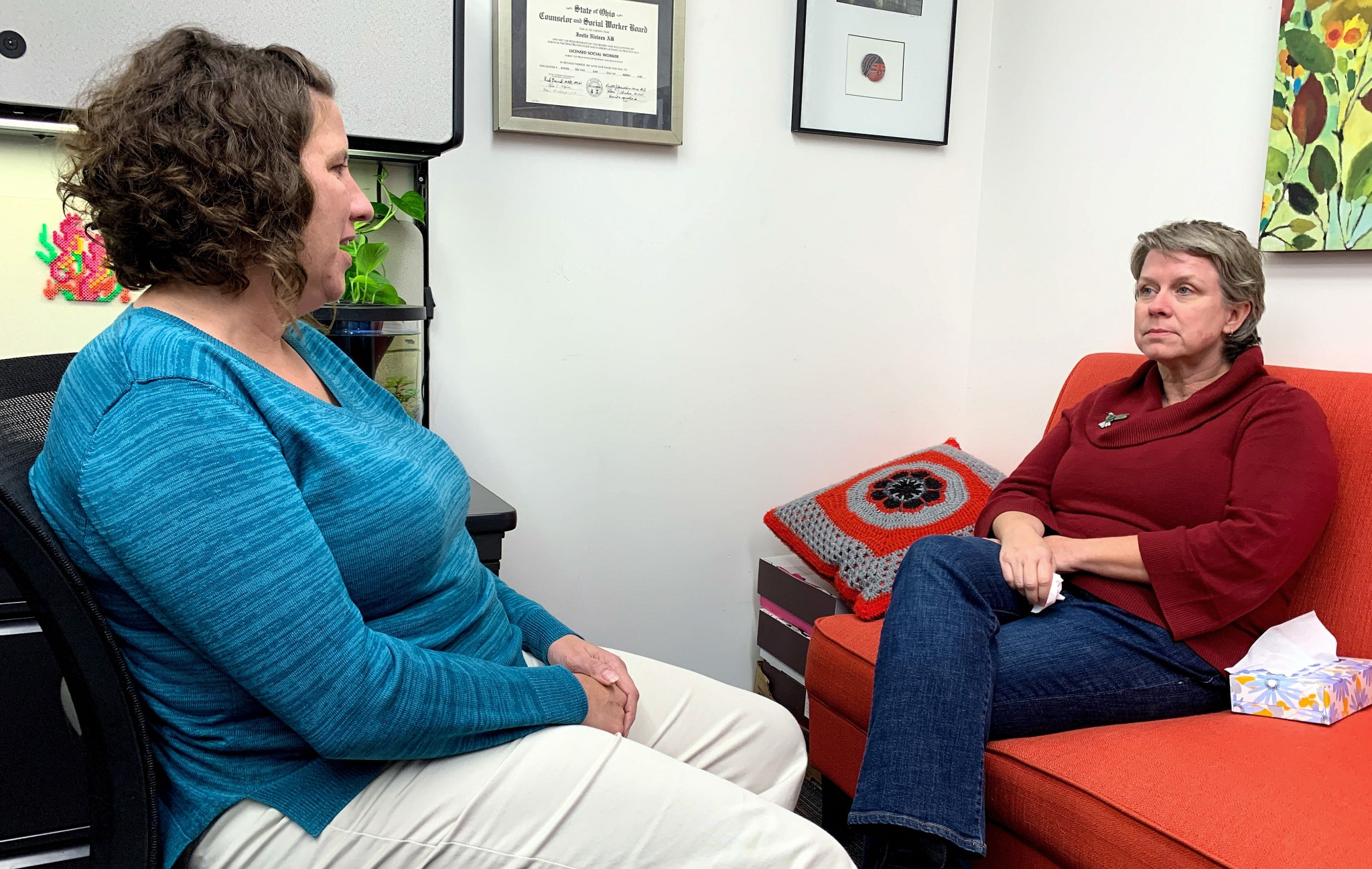 Joelle Nielsen speaks with a pet owner at The Ohio State University Veterinary Medical Center. She says that, while social workers are emerging in the veterinary field, more are needed to help pet owners through the loss of a beloved animal. (Photo courtesy of The Ohio State University Veterinary Medical Center)