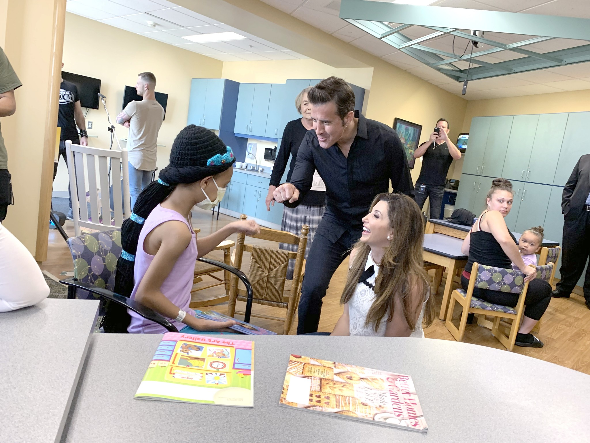 Singer Scott Stapp and his wife, Jaclyn, visit with a patient at Mercy Health – Children's Hospital on June 28. Stapp was in Toledo for a concert at Civic Music Hall. (Photo by Jeff Ziviski)