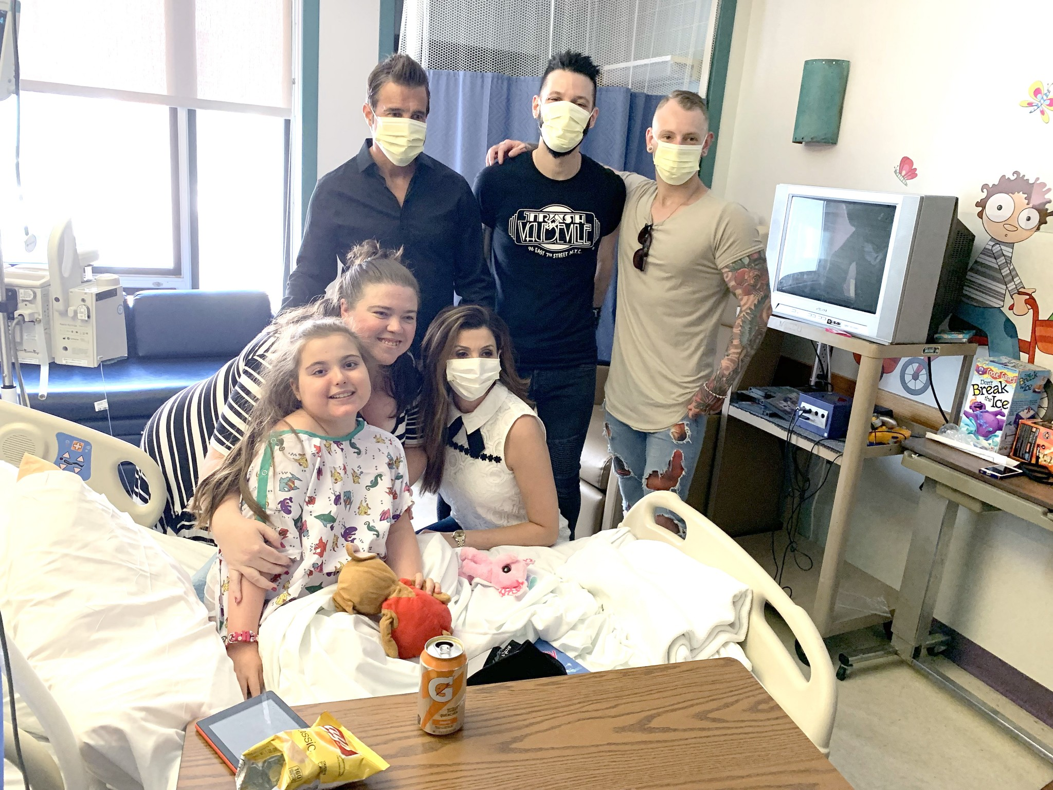 Singer Scott Stapp, former frontman for the rock band Creed, his wife Jaclyn and band members pose for photos smile behind hospital masks while visiting patients at Mercy Health – Children's Hospital during a June 28 visit. (Photo by Jeff Ziviski)