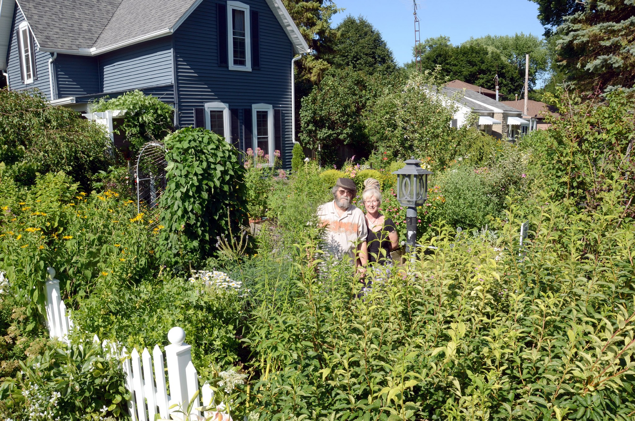 The lush yard of Michael and Victoria Lincicome, Elmore, is a certified waystation for the monarch butterfly. (Press photo by Ken Grosjean)
