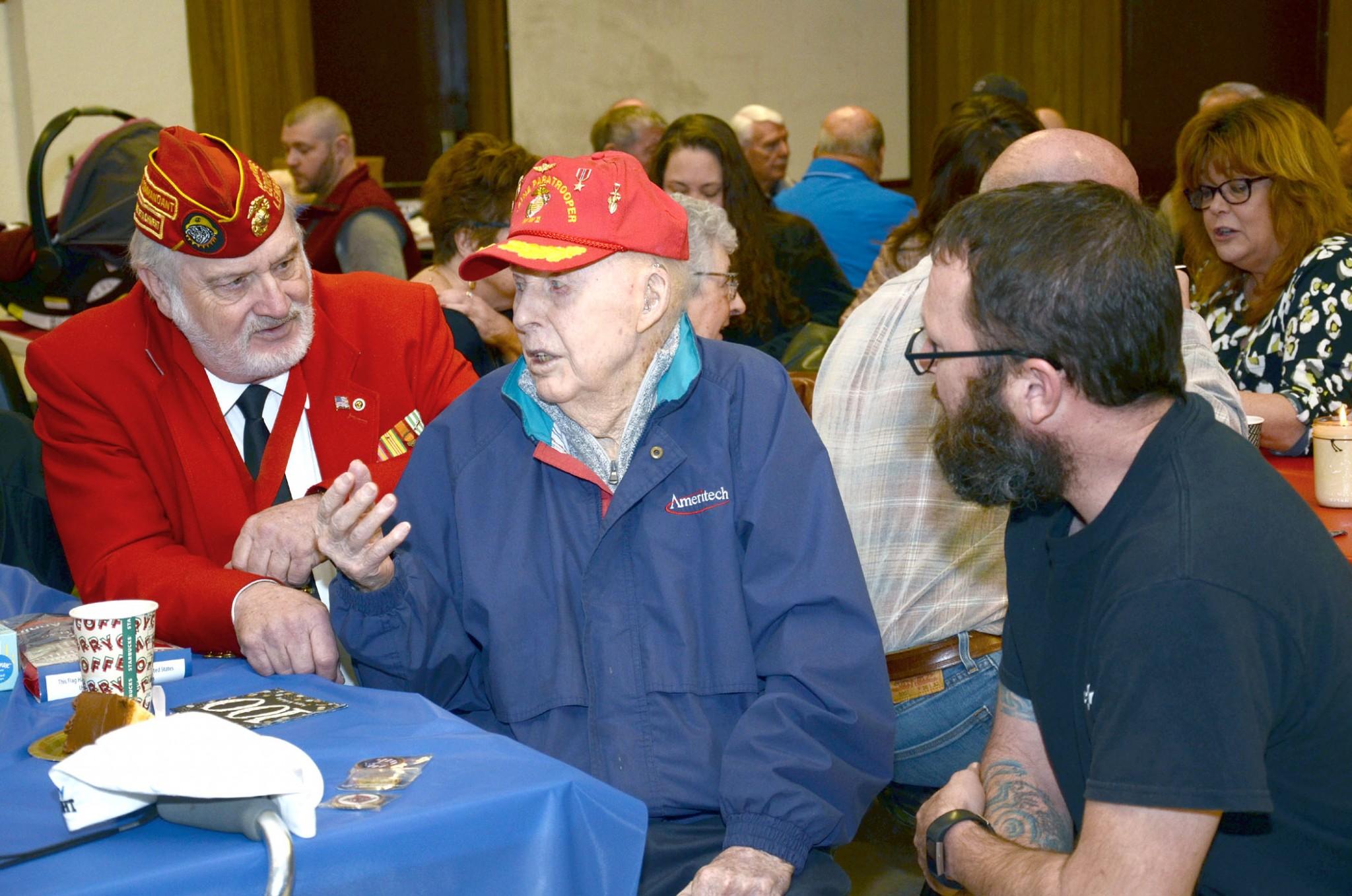 Tom Siefke talks with Bob Baker, left, commander of Marine Corp League Lou Diamond Detachment 272 and James Jacob, 1st sergeant, retired, 1st Battalion, 24th Marines. (Press photo by Ken Grosjean)