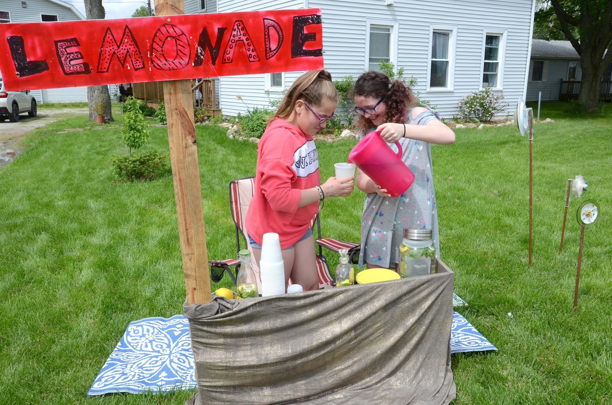 Young entrepreneurs<br />Rylee Harteis, left, and Hailey Biddex are ready for customers at their lemonade stand on State Route 795, Millbury. The two Lake Middle School students made lemonade infused with mint, and also sold cookies. The young entrepreneurs were also looking forward to the last day of school. (Press photo by Ken Grosjean)