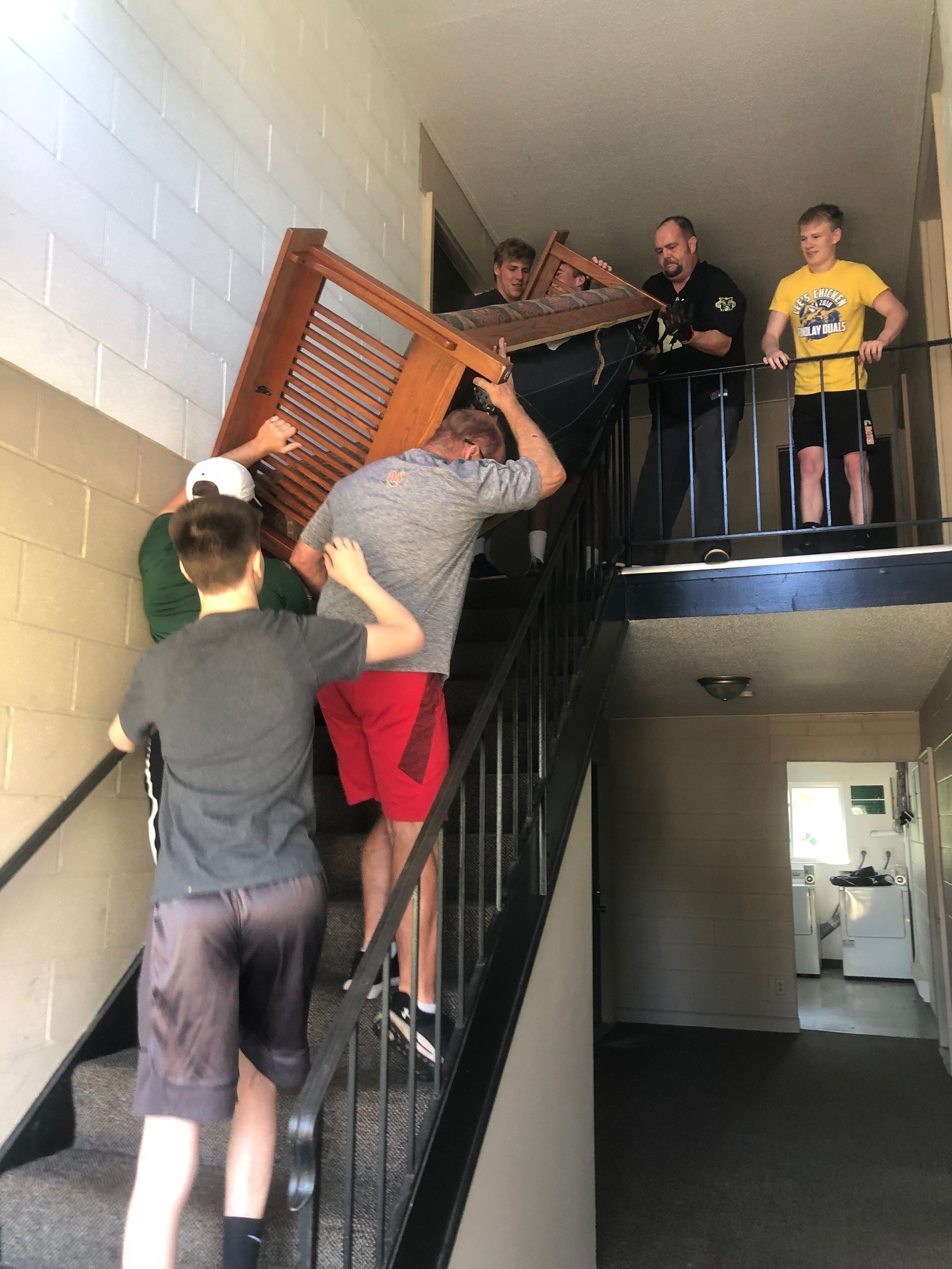 Oak Harbor High School wrestling team members and their coach, George Bergman, recently assisted the Ottawa County Veterans Service Office by helping a local veteran move furniture into his new apartment. (Submitted photo)