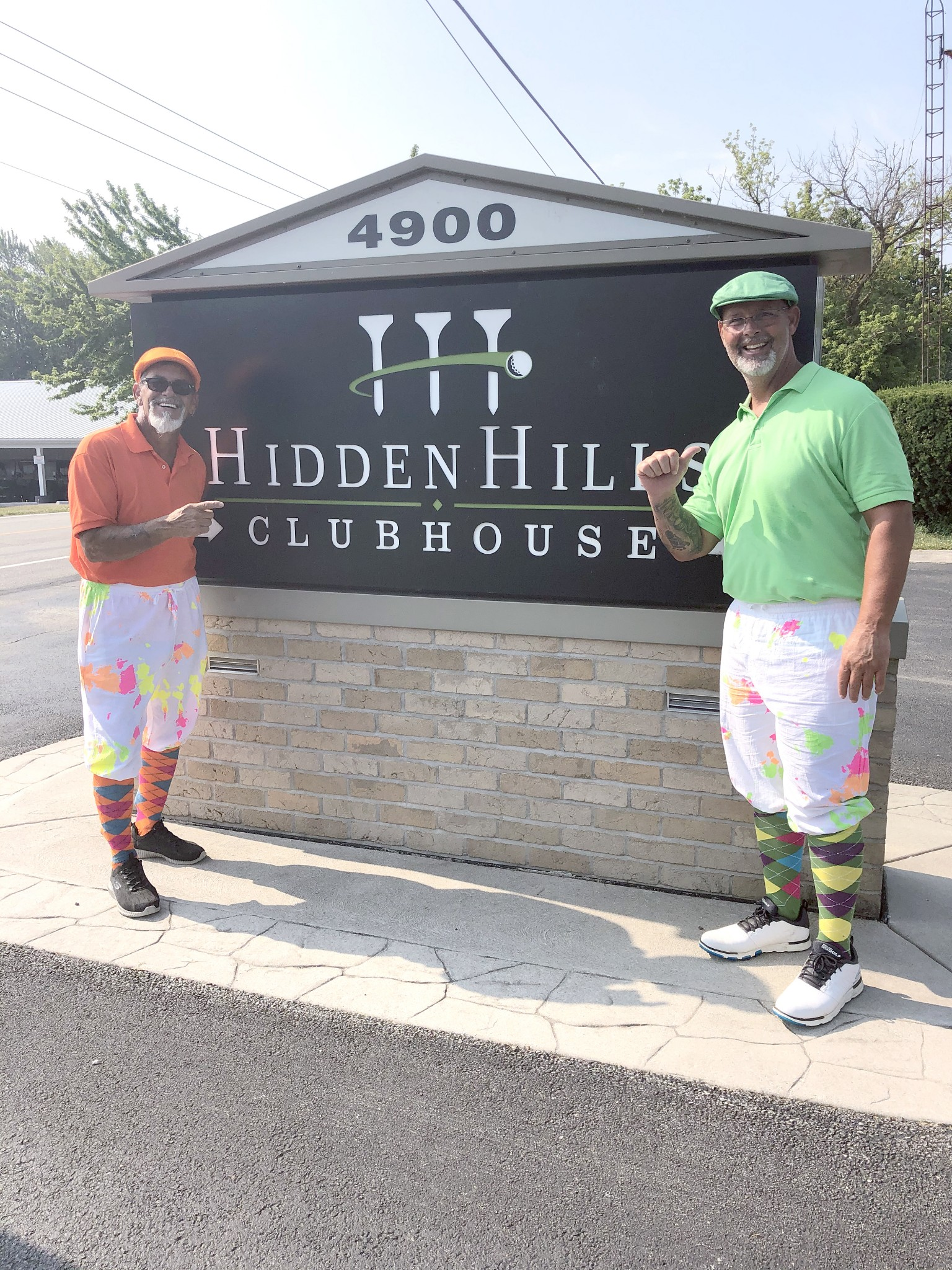 Bernie Anderson, a 27-year military veteran, at right after getting his first hole in one. At left is golf buddy Trevor Hyter (Photo courtesy Matt Hecht/Hidden Hills Golf Club)