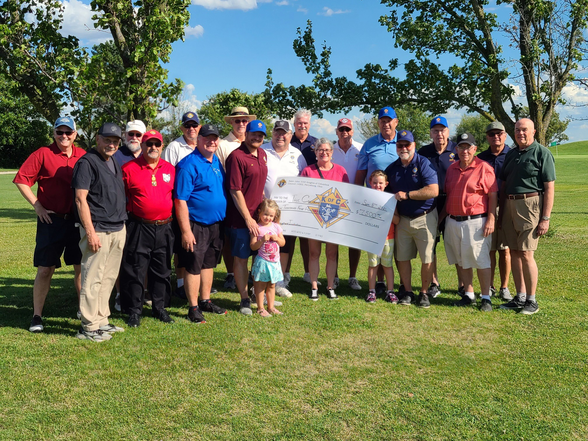 Robin Guidera (center), development and communications director for The Cocoon, along with several members of Knights of Columbus Council 14502, including golf outing committee members Daryl Brunswick (chairman), Larry Turner, Bob Wyma, Dennis Bialecki, Jerry Radwanski, and Rich Jun.