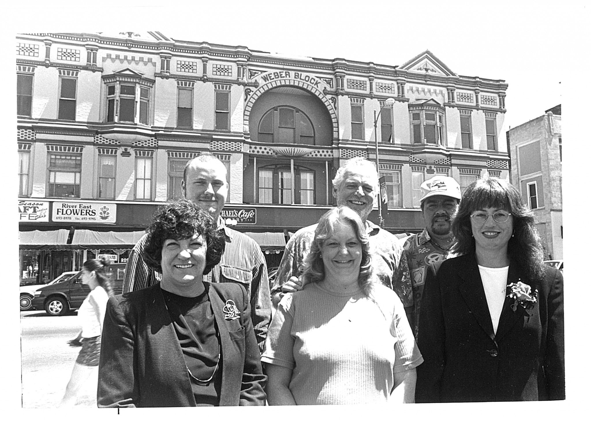 Mary Ellen Poturalski (lower row, far left) with the rest of the River East Economic Revitalization Corporation staff. Then-Executive Director Don Monroe is in the back row, center. (Press file photo by Ken Grosjean)