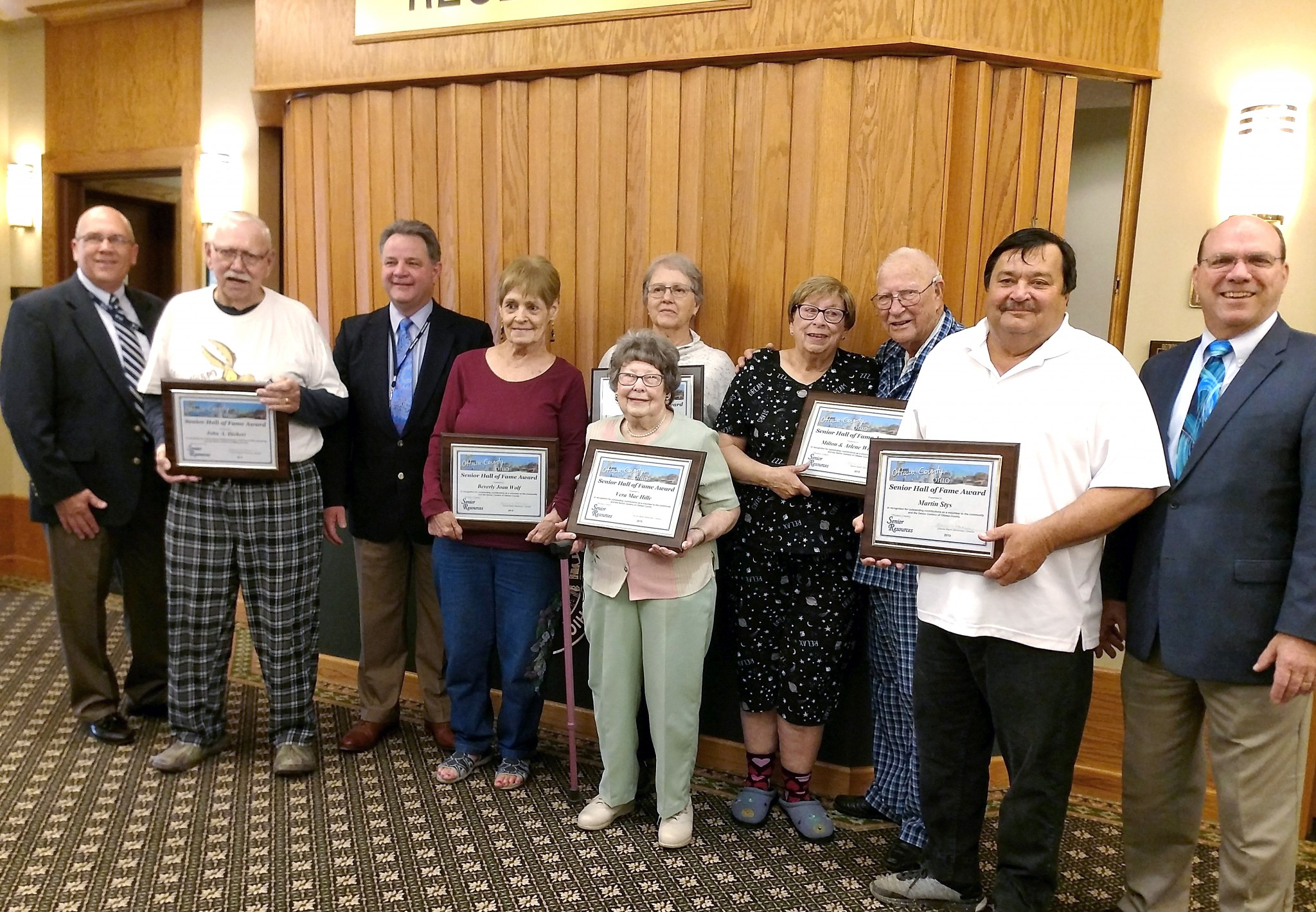 (Left to right), Ottawa County Commissioner Don Douglas, John Diebert, Commissioner Mark Stahl, Joan Wolf, Vera Hille (in front), Sara Toole, Arlene and Milton Wilburn, Marty Stys and Commissioner Mark Coppeler (Submitted photo)