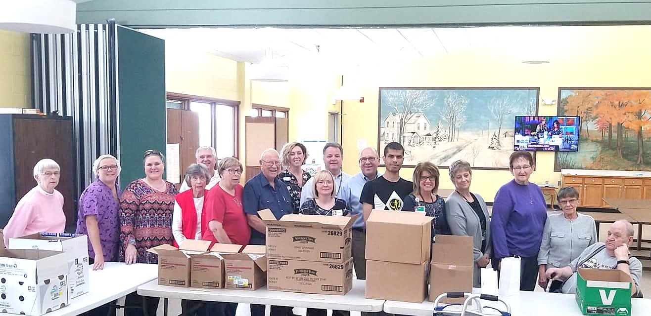 Volunteers recently helped Ottawa County Senior Resources pack shelf-stable meals for clients to have in the event hot meals cannot be delivered due to weather emergencies. (Submitted photo)