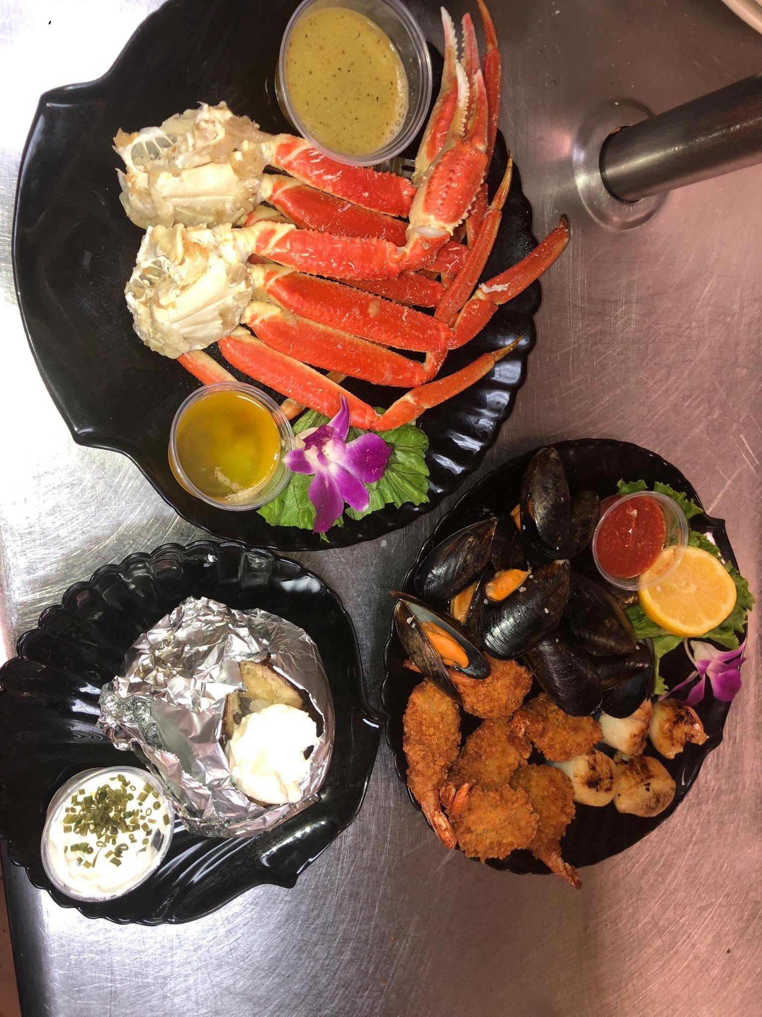 """A popular choice on the  Hartford House menu is """"Taste of the Oceans,"""" according to cook Hunter Foltz. The entree includes Northern Atlantic snow crab, Gulf shrimp, Mediterranean mussels and sea scallops. (Submitted photo)"""