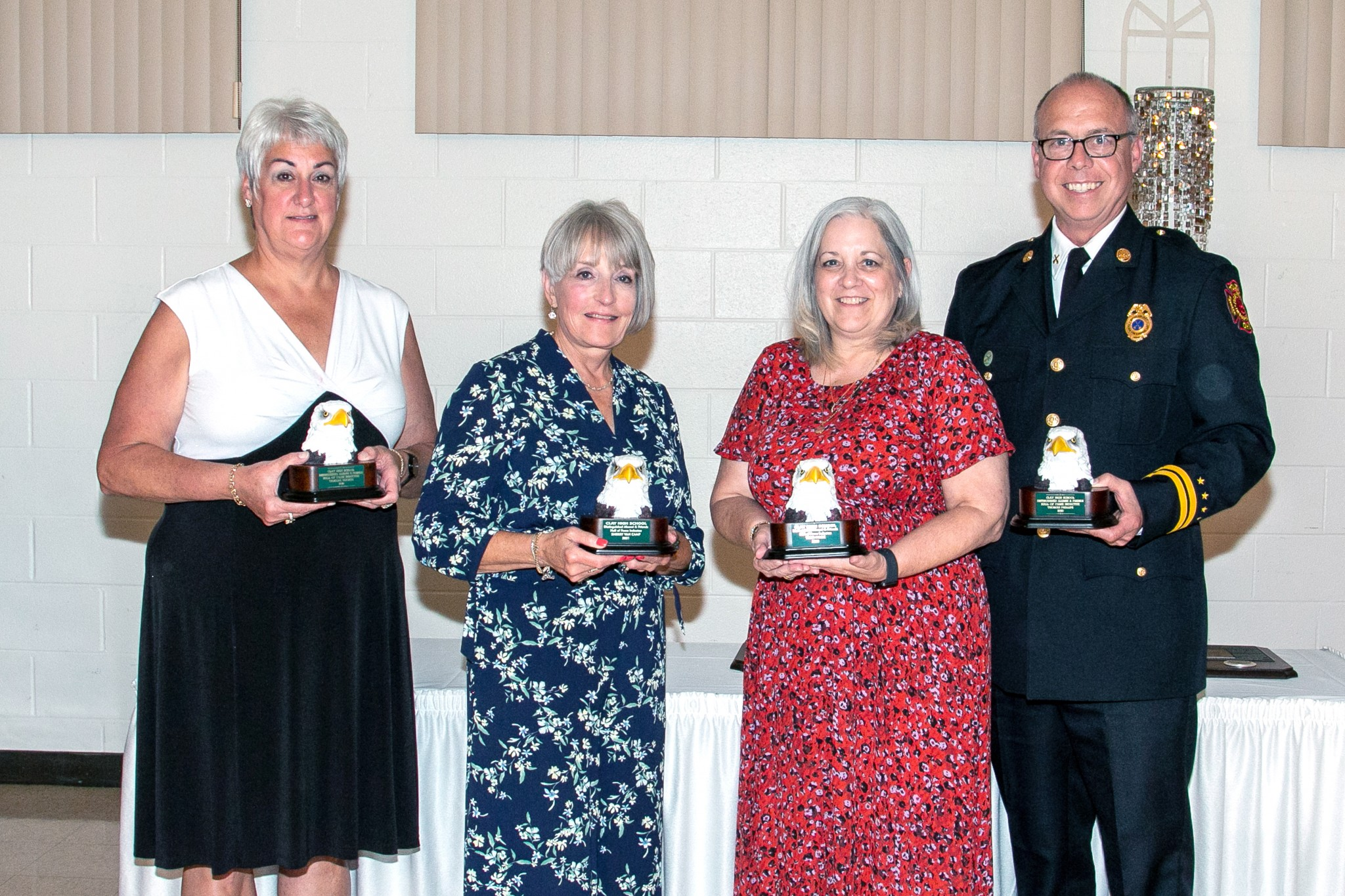 Four Clay High School graduates were inducted as Distinguished Alumni at a banquet held Sept. 16. They include, from left, Tamara Hughes, Sherry Van Camp, Terri Wamer Hook and Thomas Phillips. (Photo by Amy Hansen)