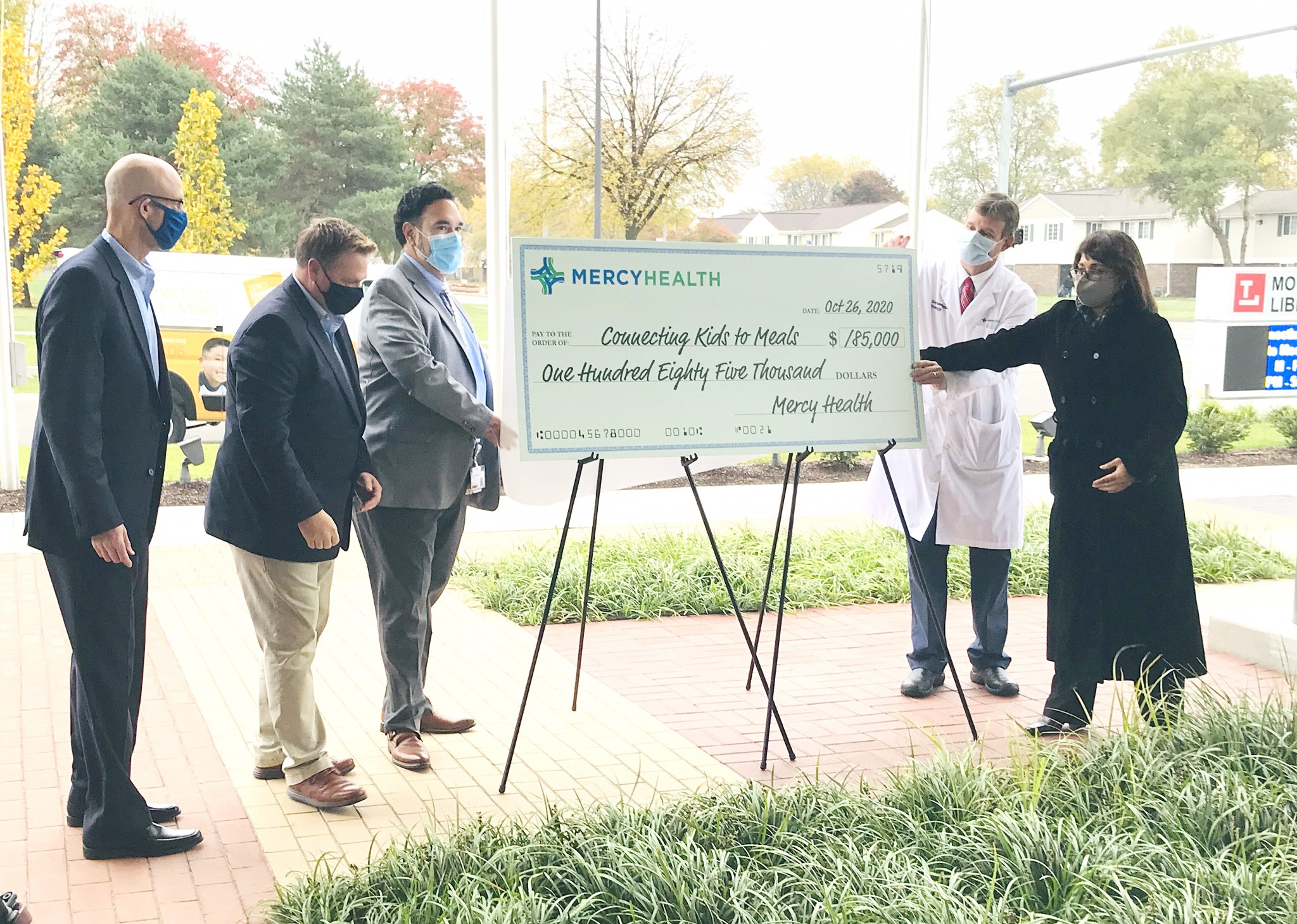 On Oct. 26, representatives from Connecting Kids to Meals accepted a $185,000 donation from Mercy Health and its medical staff and the Toledo Federation of Teachers. The nonprofit will use the funds to provide hot meals to children in the area's low-income and underserved areas. (Submitted photo)