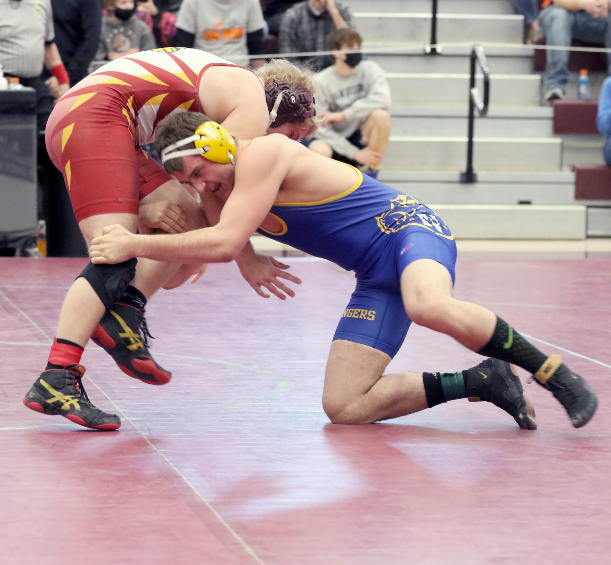 Northwood senior Hunter Schmoekel wrestles Edgerton's Jordan Warner in a 170 pound match. (Photo by Doug Hise)