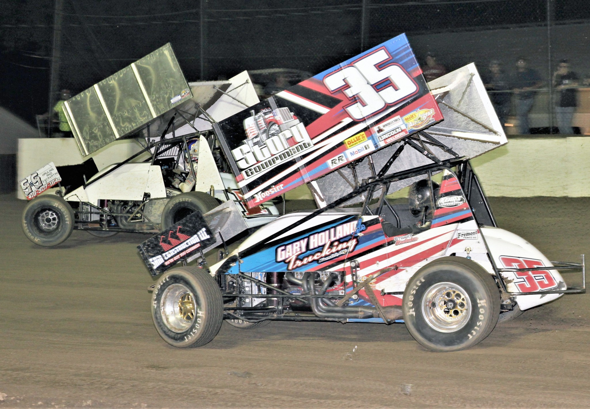Nate Dussel (1) and Gibsonburg-Helena area native Stuart Brubaker (35) battle for the lead with Dussel motoring away to win the AFCS 410 Sprints feature and $5,000 at Fremont Speedway. Brubaker was second. (Photo by Rick Sherer)