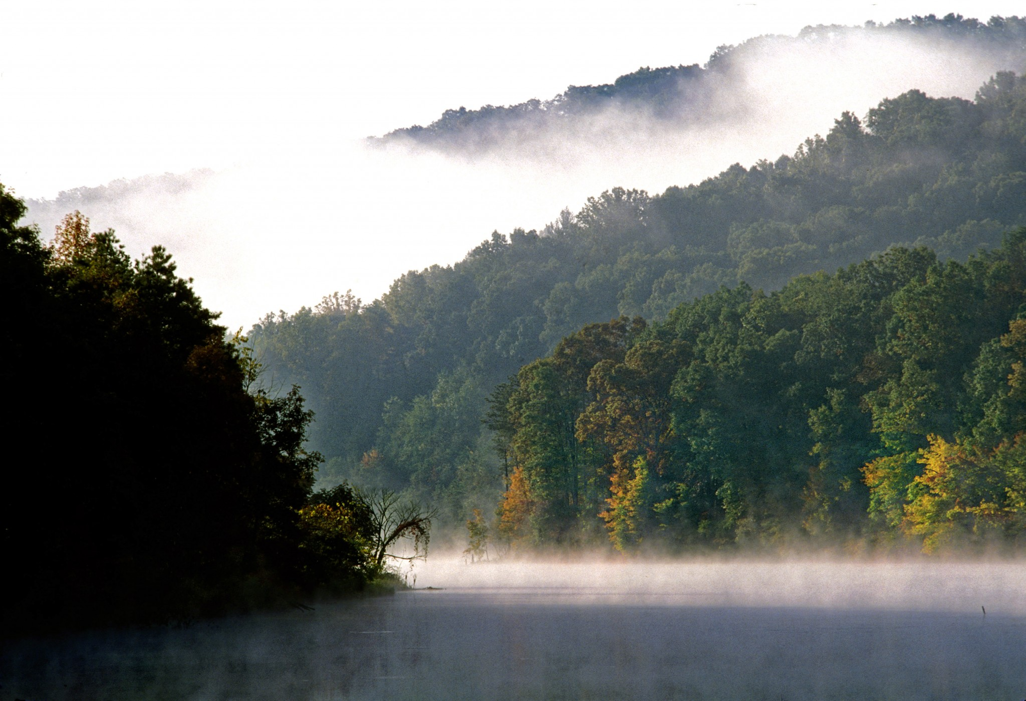 Fog lays between the ridges that slope into Turkeyfoot Lake, located below the Shawnee Lodge. The region is nicknamed the Little Smokies because, like the Smokies, there is often moisture hanging in the air above the tens of thousands of acres of deciduous forest. (Photo by Art Weber)