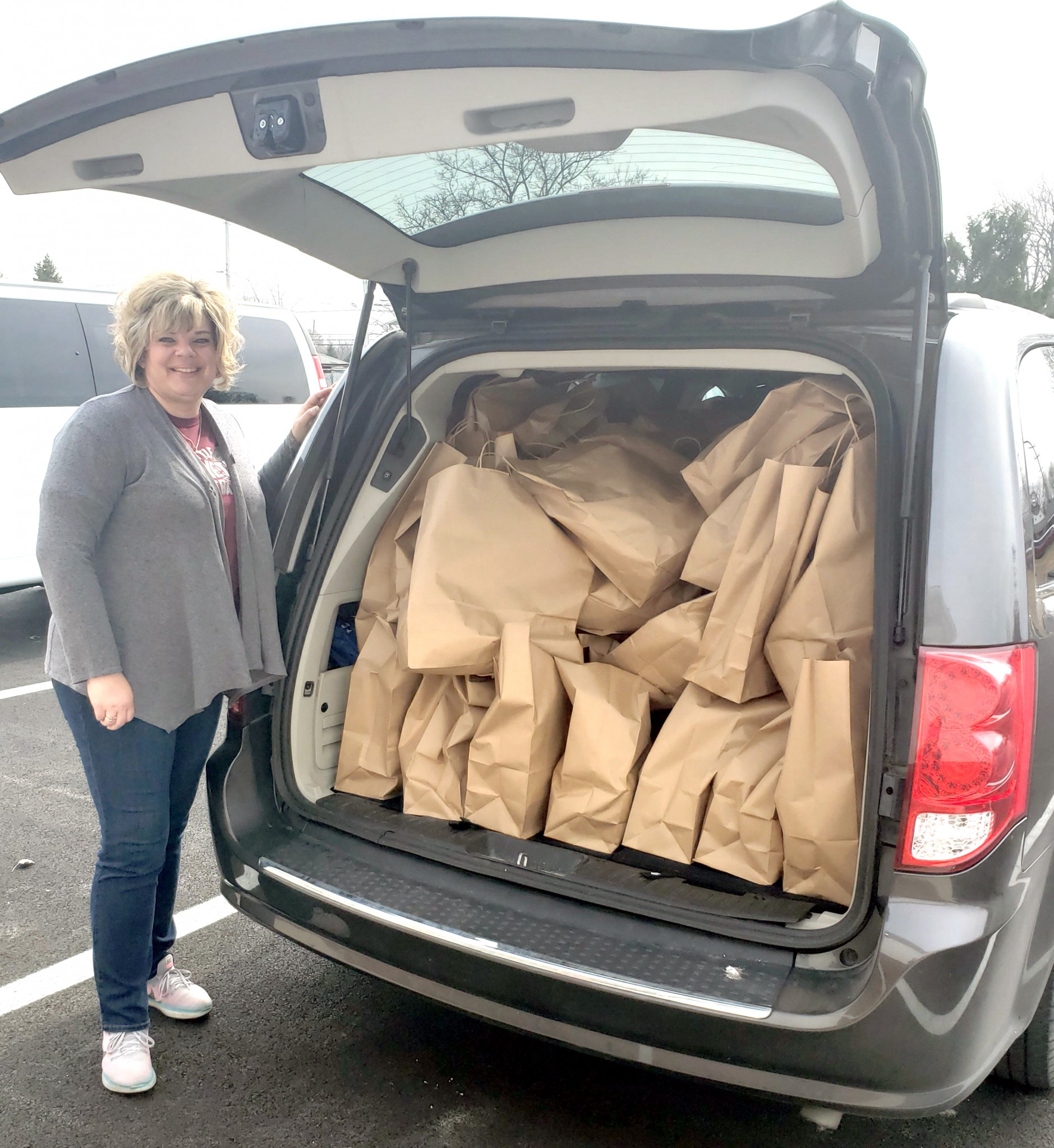 Melissa Antry, staff member at the Otttawa County Advocacy Center and coordinator of the mentoring program at Genoa Schools, prepares to deliver meals for distribution to Genoa students over spring break. (Submitted photo)