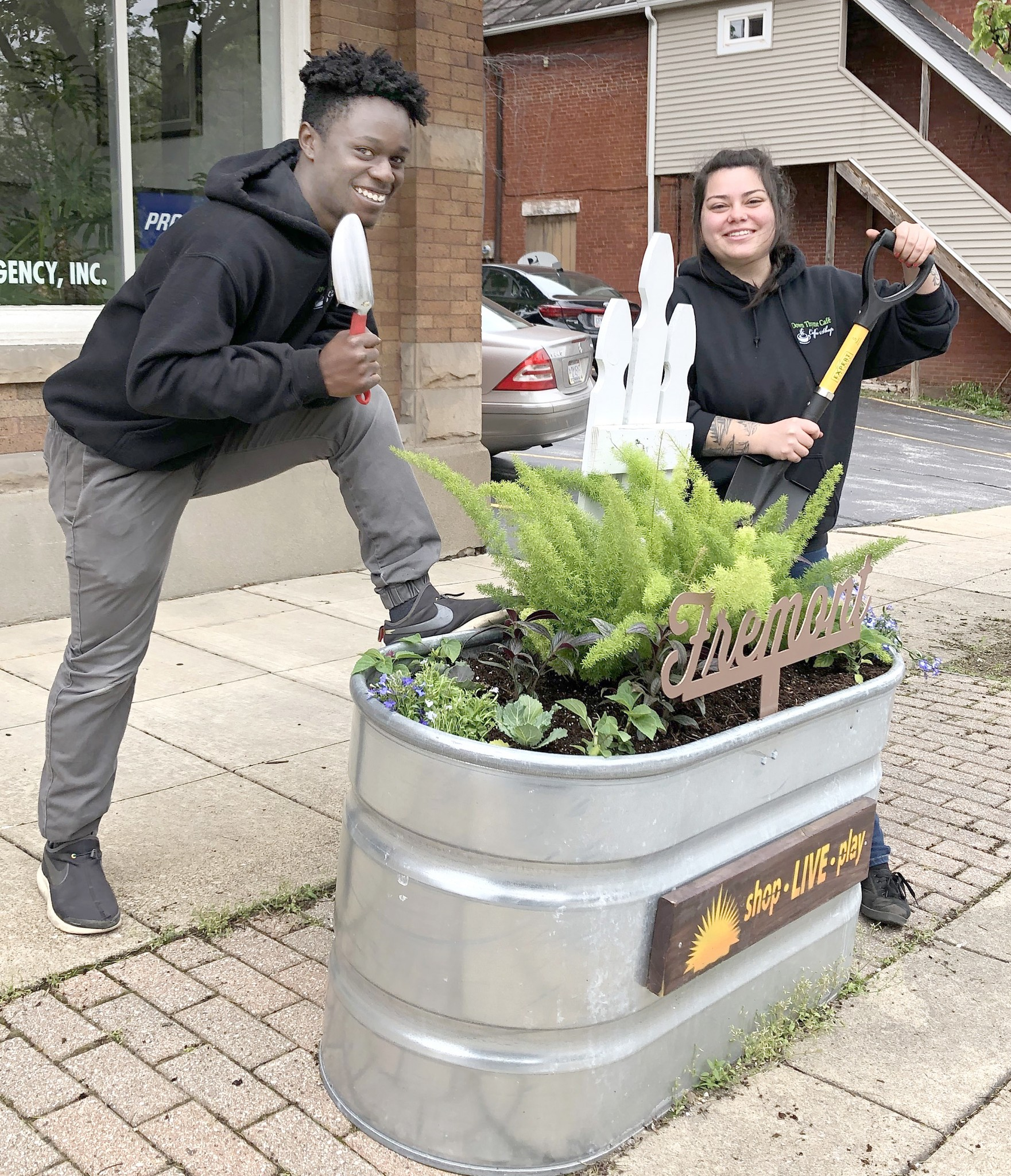 Employees from The Garrison restaurant, in partnership with Downtown Fremont, Inc., created three different designs for downtown planters as part of a cleanup and beautification of the downtown area. (Submitted photo)