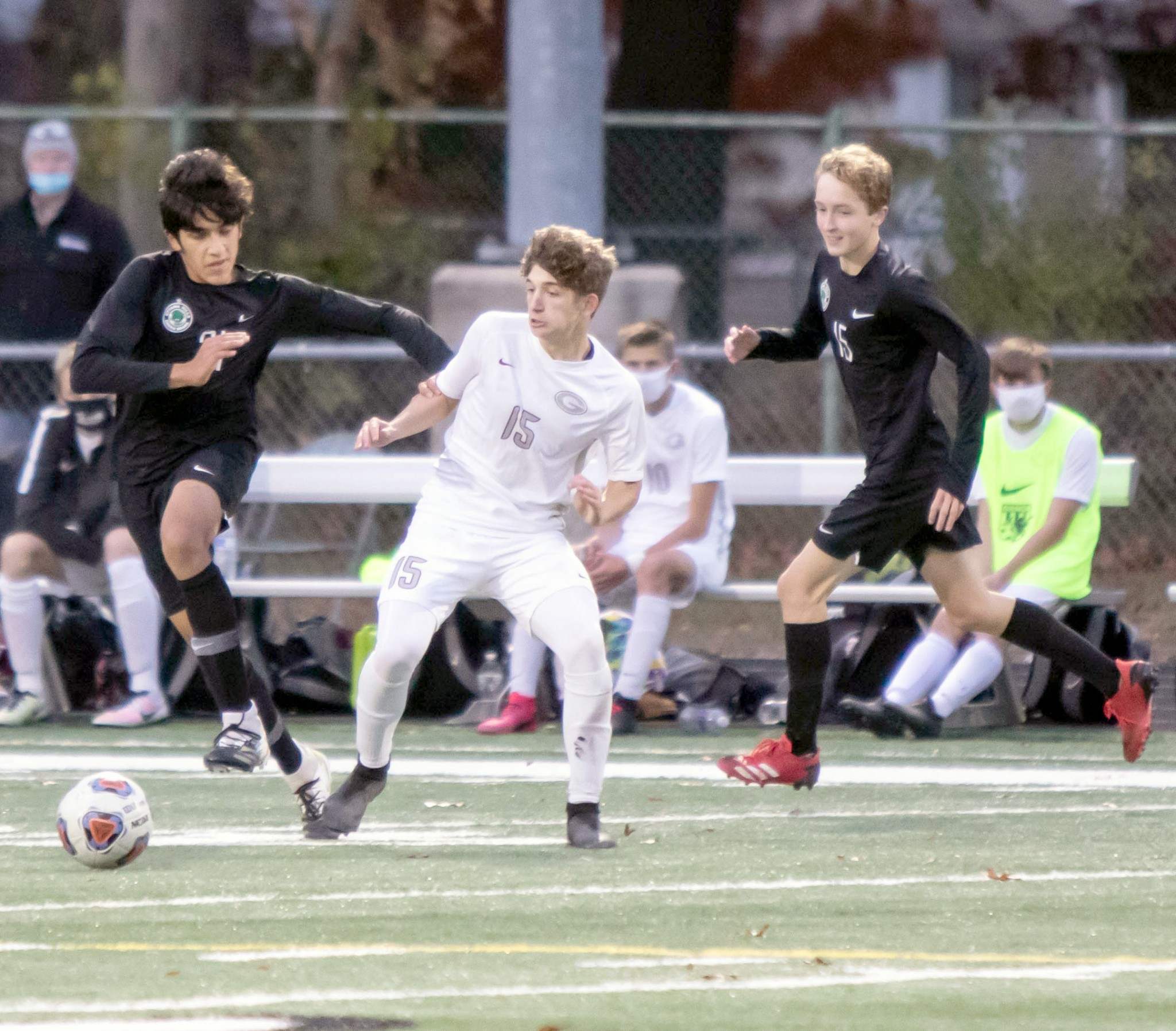 """Genoa forward Griffin Meyer (15) tries to get past two Ottawa Hills defenders in last year&#039;s tournament game. (Press file photo by Harold Hamilton/<a href=""""http://www.HEHPhotos.smugmug.com"""">www.HEHPhotos.smugmug.com</a>)"""